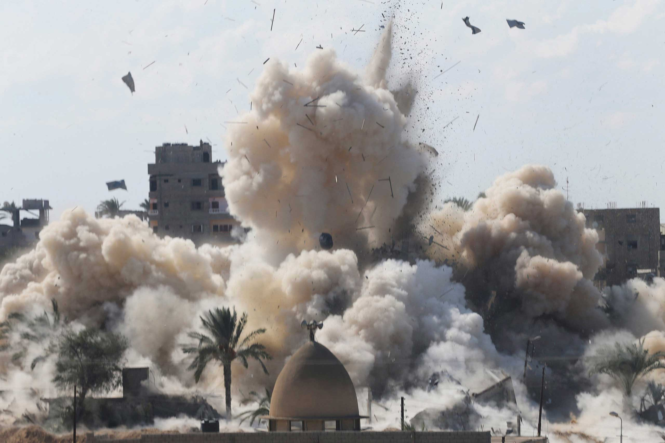 Oct. 29, 2014. Smoke rises after a house was blown up during a military operation by Egyptian security forces in the Egyptian city of Rafah, near the border with southern Gaza Strip. At least 33 Egyptian security personnel were killed on Friday in the Sinai Peninsula bordering Israel and Gaza, in an attack on a checkpoint that bore the marks of assaults claimed by Egypt's most active militant group Ansar Bayt al-Maqdis.
