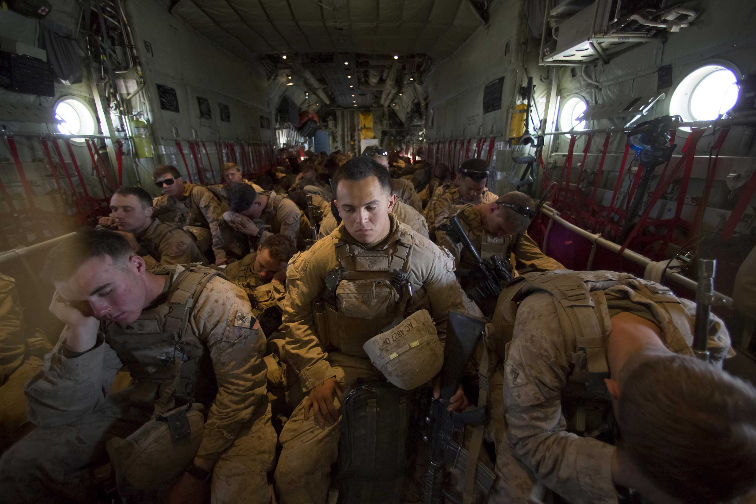 Oct. 26, 2014. After handing over their guard post to the Afghan National Army counterparts, some of the last Marines left on Camp Leatherneck crowd into a C-130 at Bastion Airfield for the official withdrawal of U.S. Marines from Helmand Province, Afghanistan.