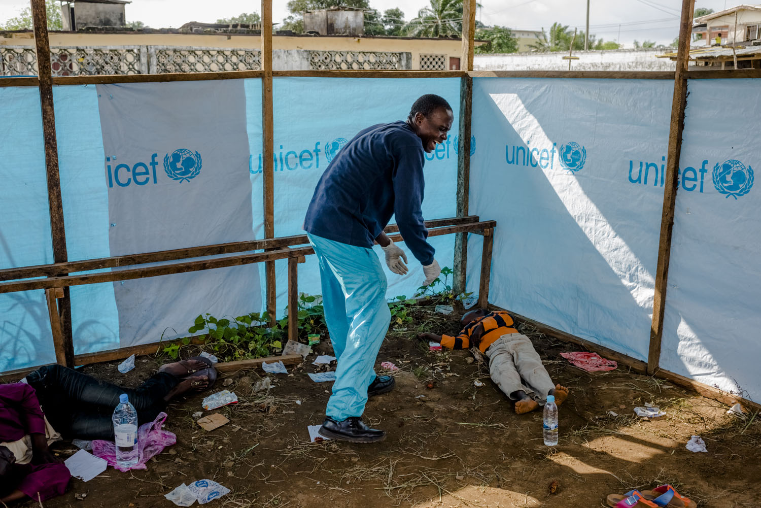 Edward Dorbor reacts after believing that his son, James Dorbor, 8, had died. However, the boy survived for a few additional hours before dying at the JFK Ebola treatment center on Sept. 5, 2014 in Monrovia, Liberia.