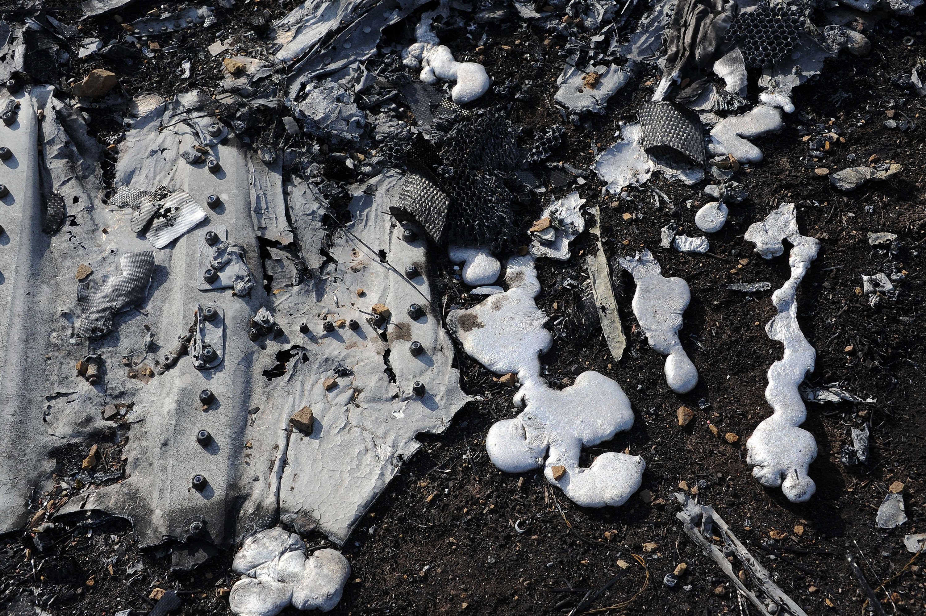 Solidified molten steel is pictured among the wreckage of Malaysia Airlines flight MH17 near the village of Rassipnoe, Ukraine on on Oct. 15, 2014
