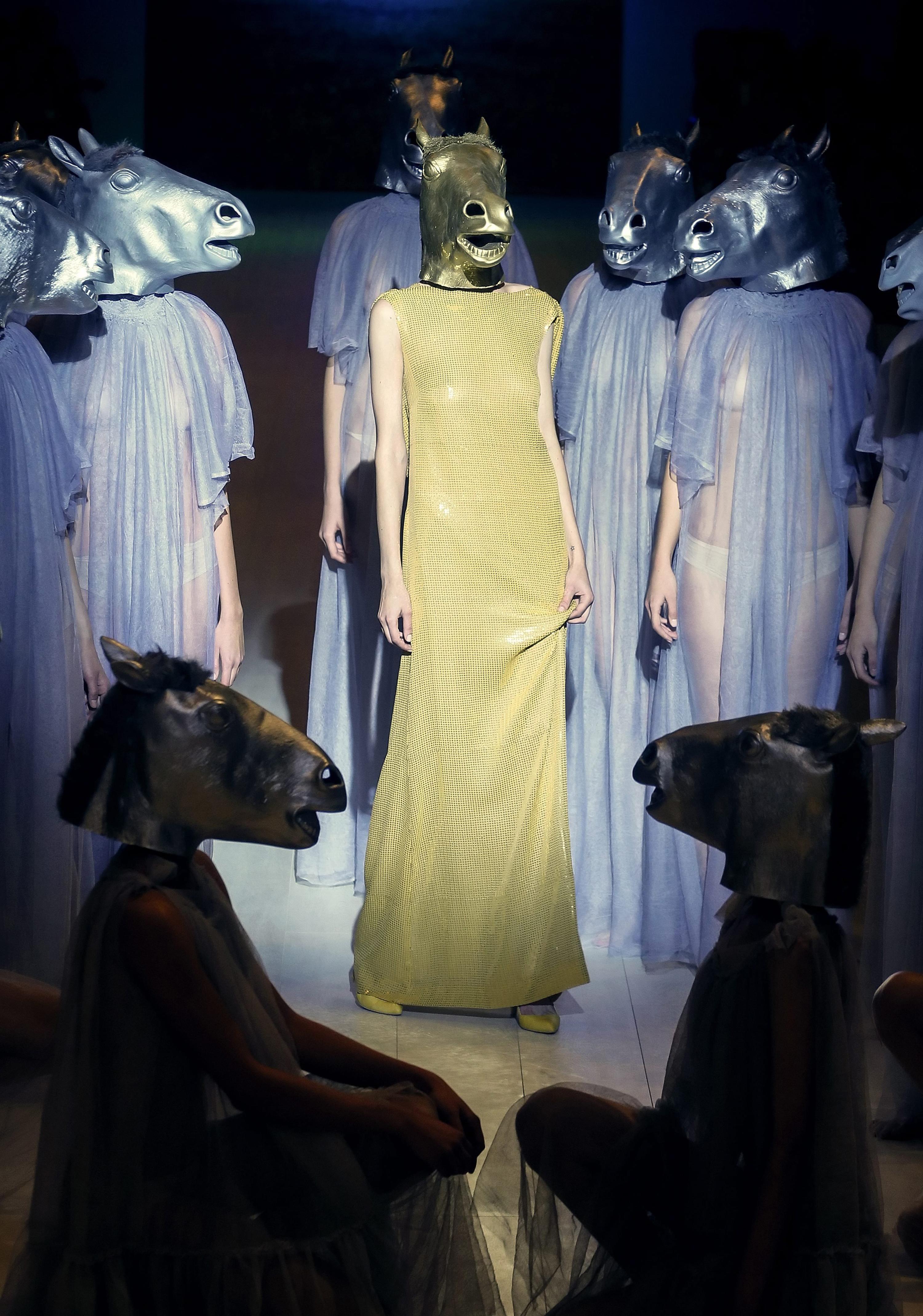 Models present creations by Ukrainian designer Victoria Gres during the Ukrainian Fashion Week in Kiev, Ukraine on Oct. 15, 2014.