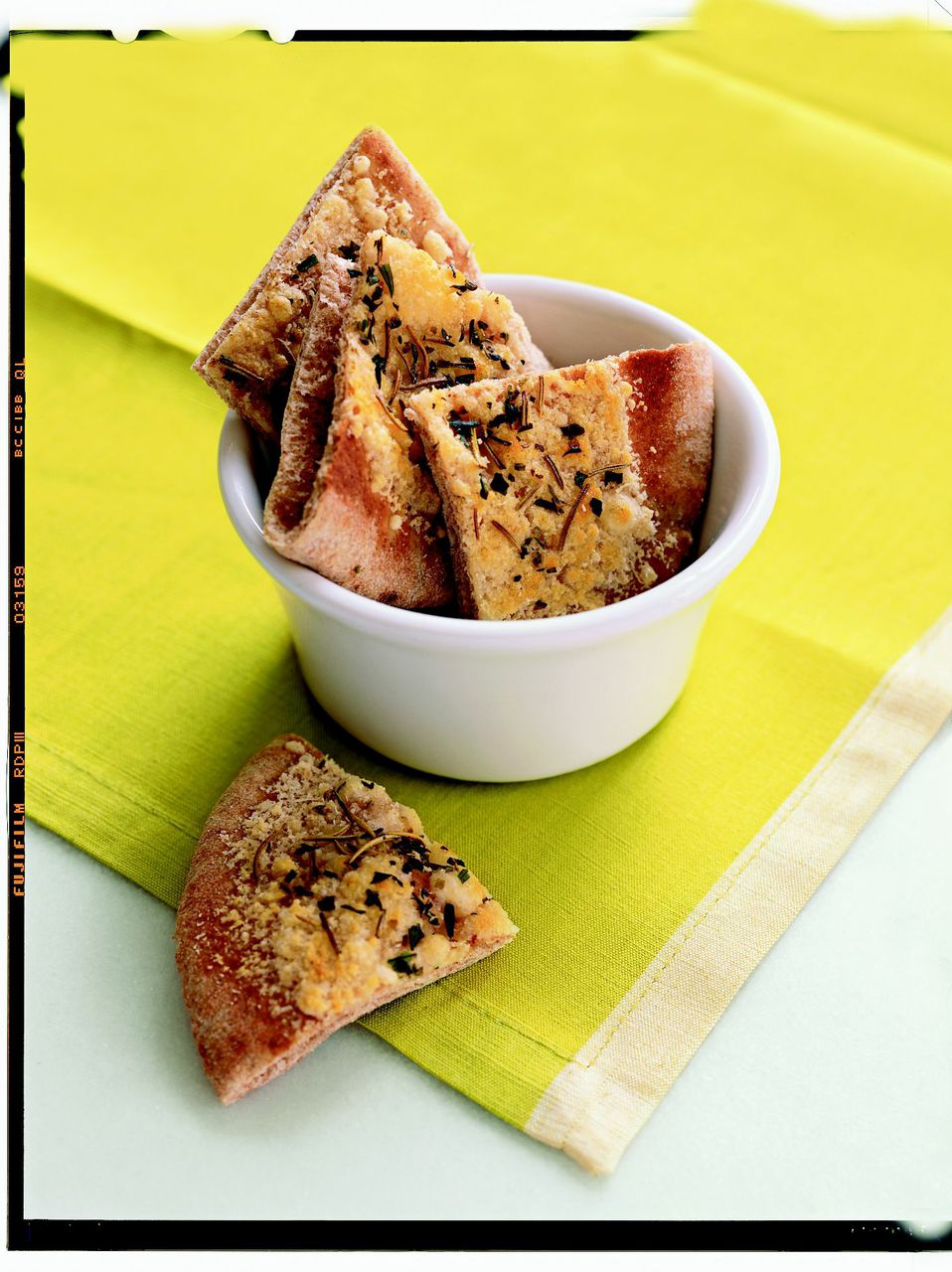 6. Parmesan Pita Crisps Sprinkle 2 tablespoons of grated Parmesan evenly over a 4-inch whole-wheat pita. Dust pita with ¼ teaspoon dried oregano and broil until the cheese browns. Cut into quarters.                                                              Health bonus: Good balance of protein, fat, and fiber.                                                              (MORE: 12 Easy Snacks for Kids)
