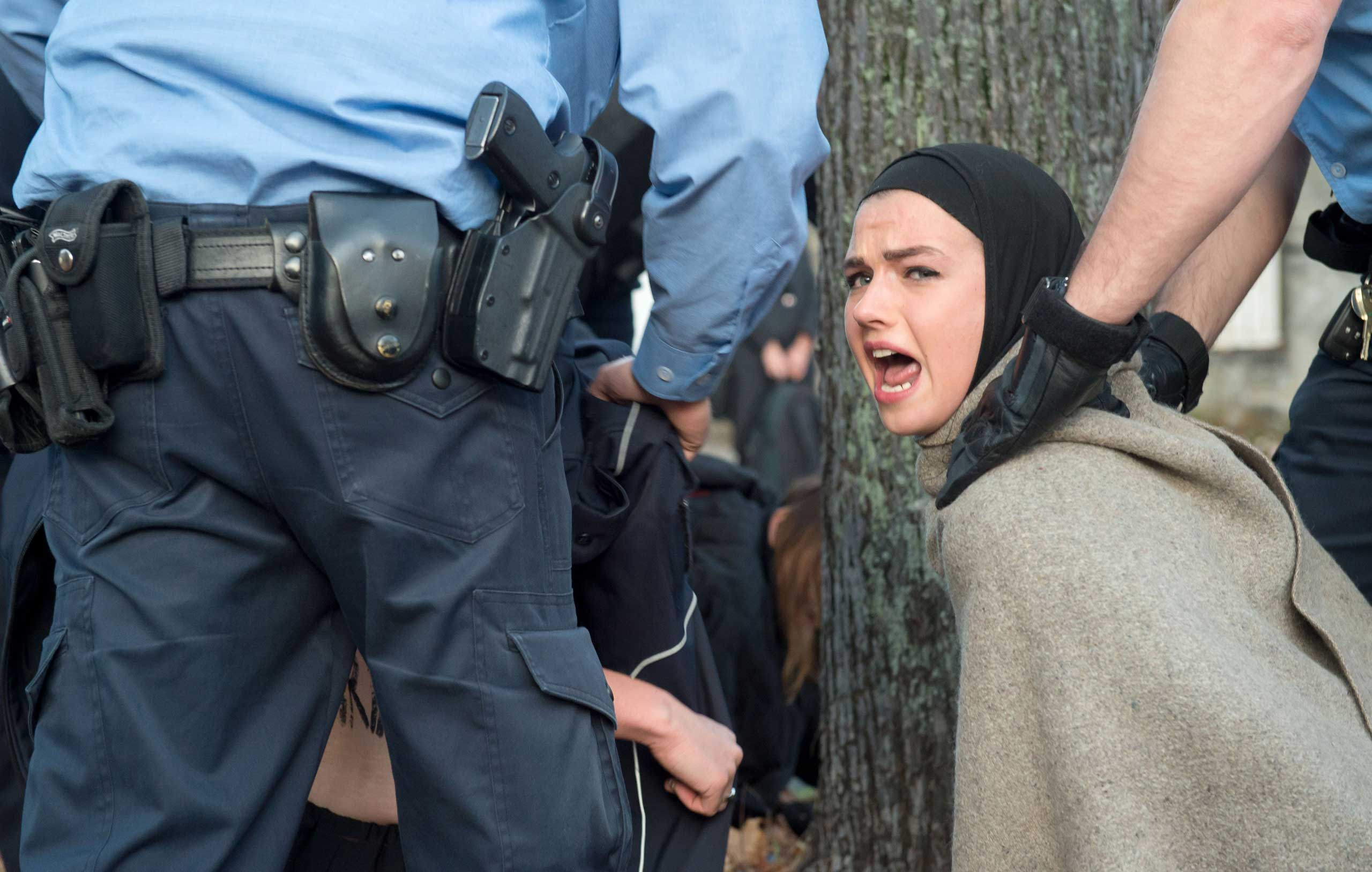 Oct. 27, 2014. Police officers clear away protestors during a demonstration of feminist organization, Femen, in front of the Iranian embassy in Berlin. The protest addresses the execution of a 19-year old woman in Iran.
