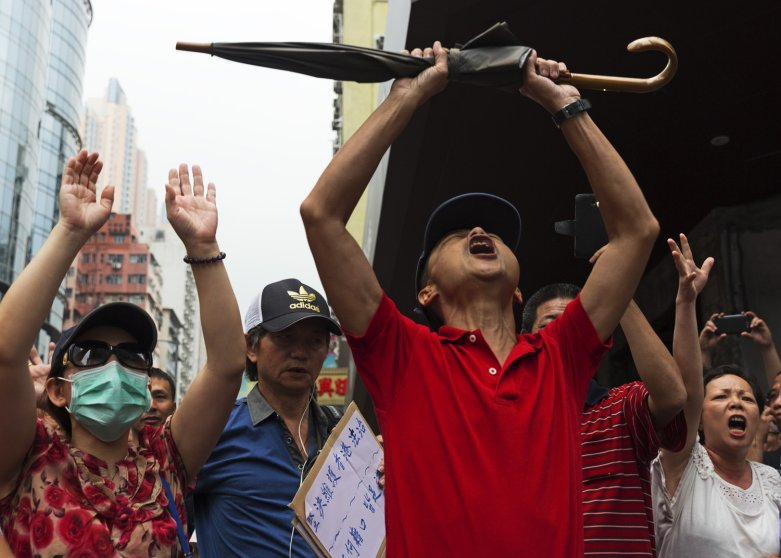 Democracy demonstrations in Hong Kong. Students and pro-democracy citizens being attacked and shouted at by anti-demonstration group in Mongkok. Pro-police rally. Joshua Wong, 17-year-old protest leader.by James Nachtwey