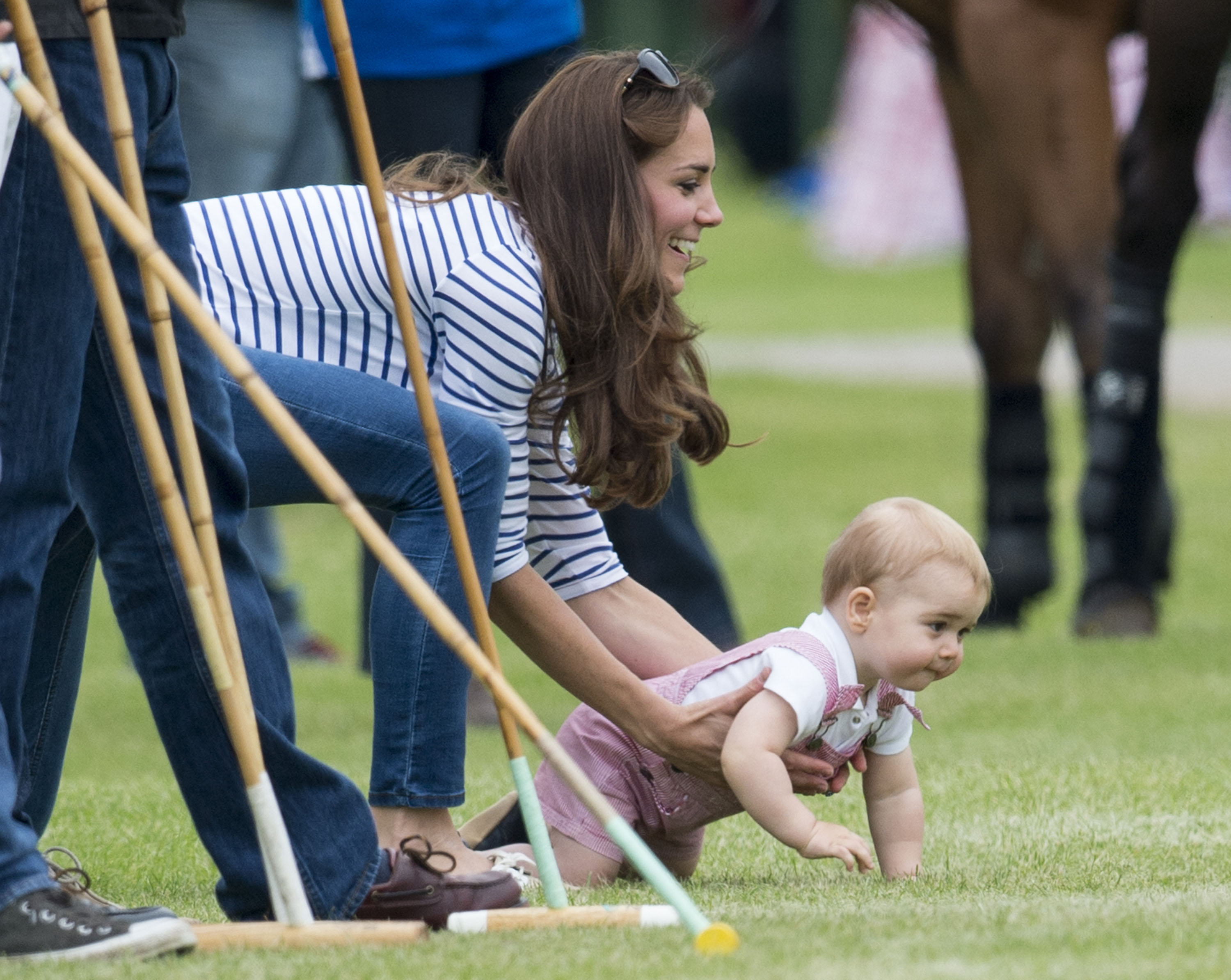Prince William, Duke of Cambridge and Prince George attend the Jerudong Park Trophy at Cirencester Park Polo Club on June 15, 2014 in Cirencester, England.  (Photo by Mark Cuthbert/UK Press via Getty Images)