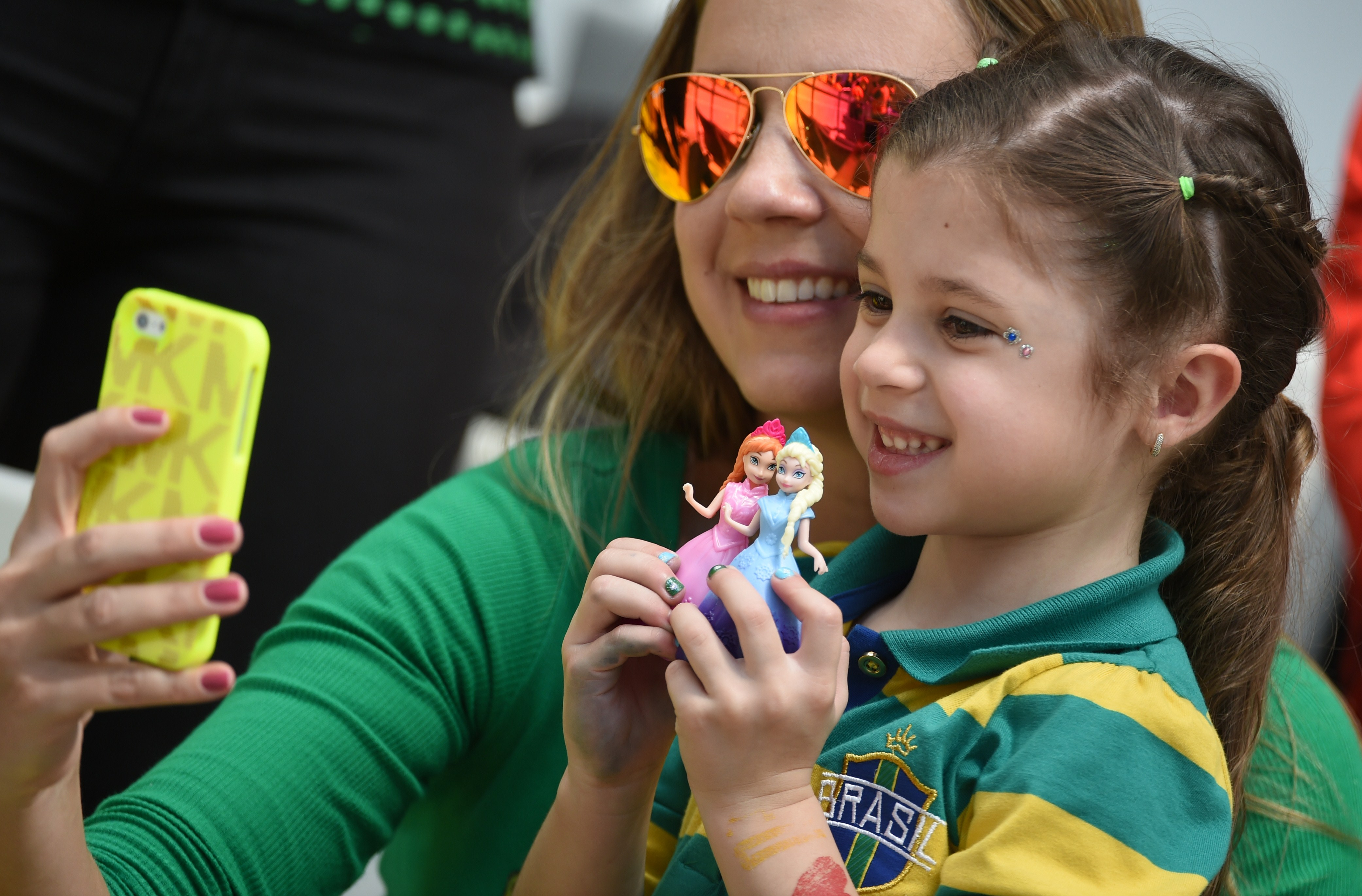 Australian fans take a picture with a smartphone before a Group B football match between Australia and Spain at the Baixada Arena in Curitiba during the 2014 FIFA World Cup on June 23, 2014.