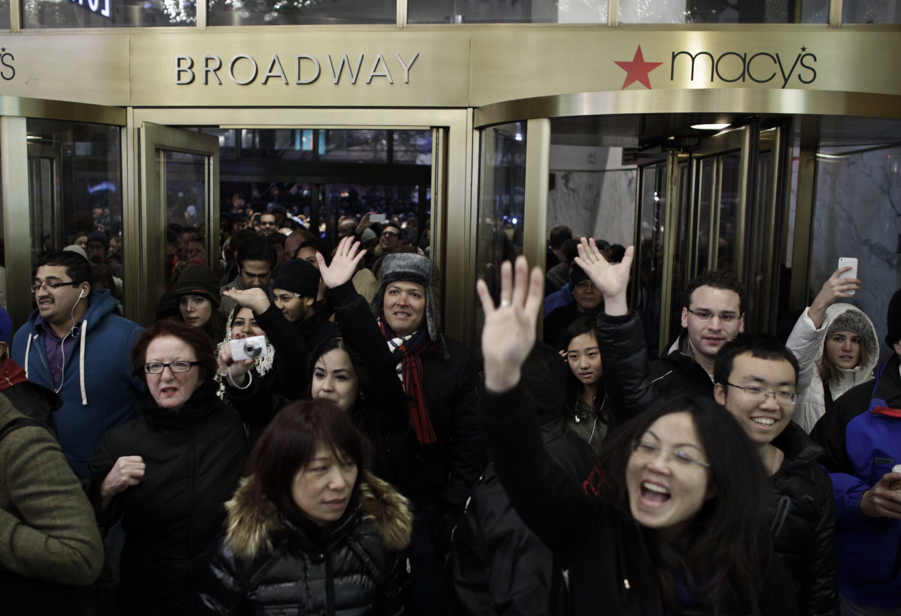 People enter Macy's Herald Square as the store opens its doors at 8 pm Thanksgiving day on November 28, 2013 in New York City