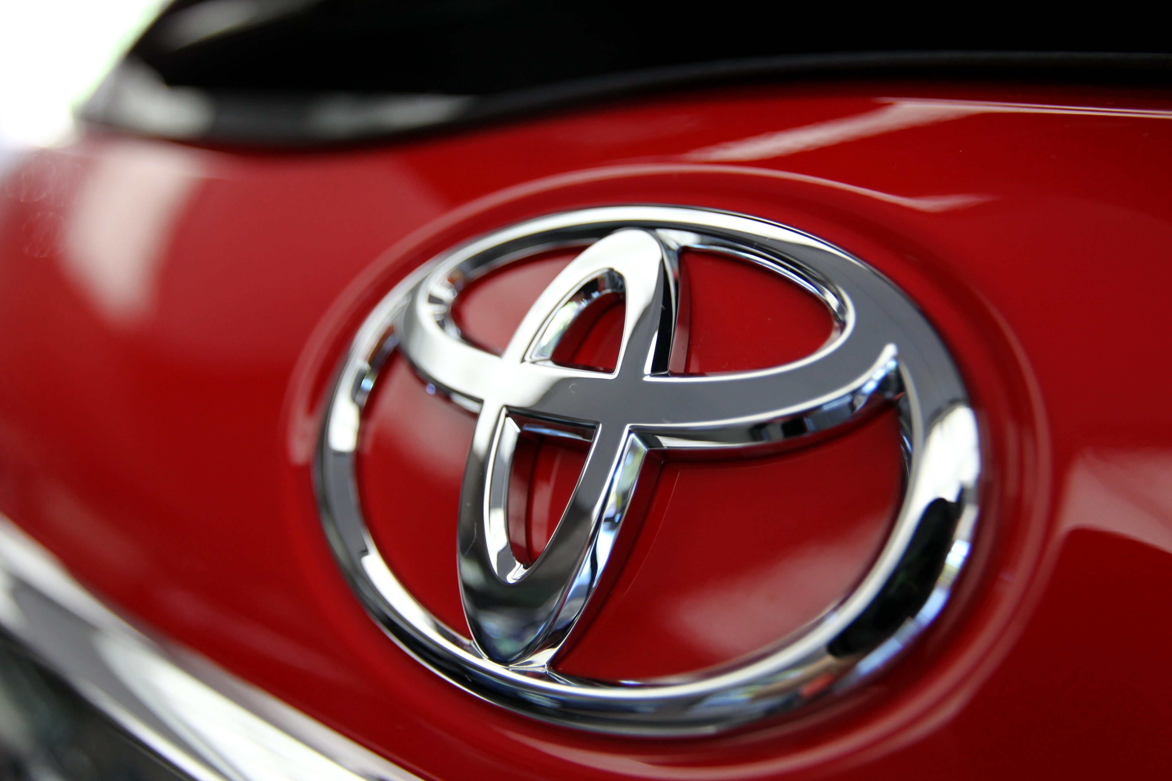 The Toyota Motor Corp. logo is displayed on an automobile at the company's headquarters in Tokyo, Japan, on Aug. 5, 2014.