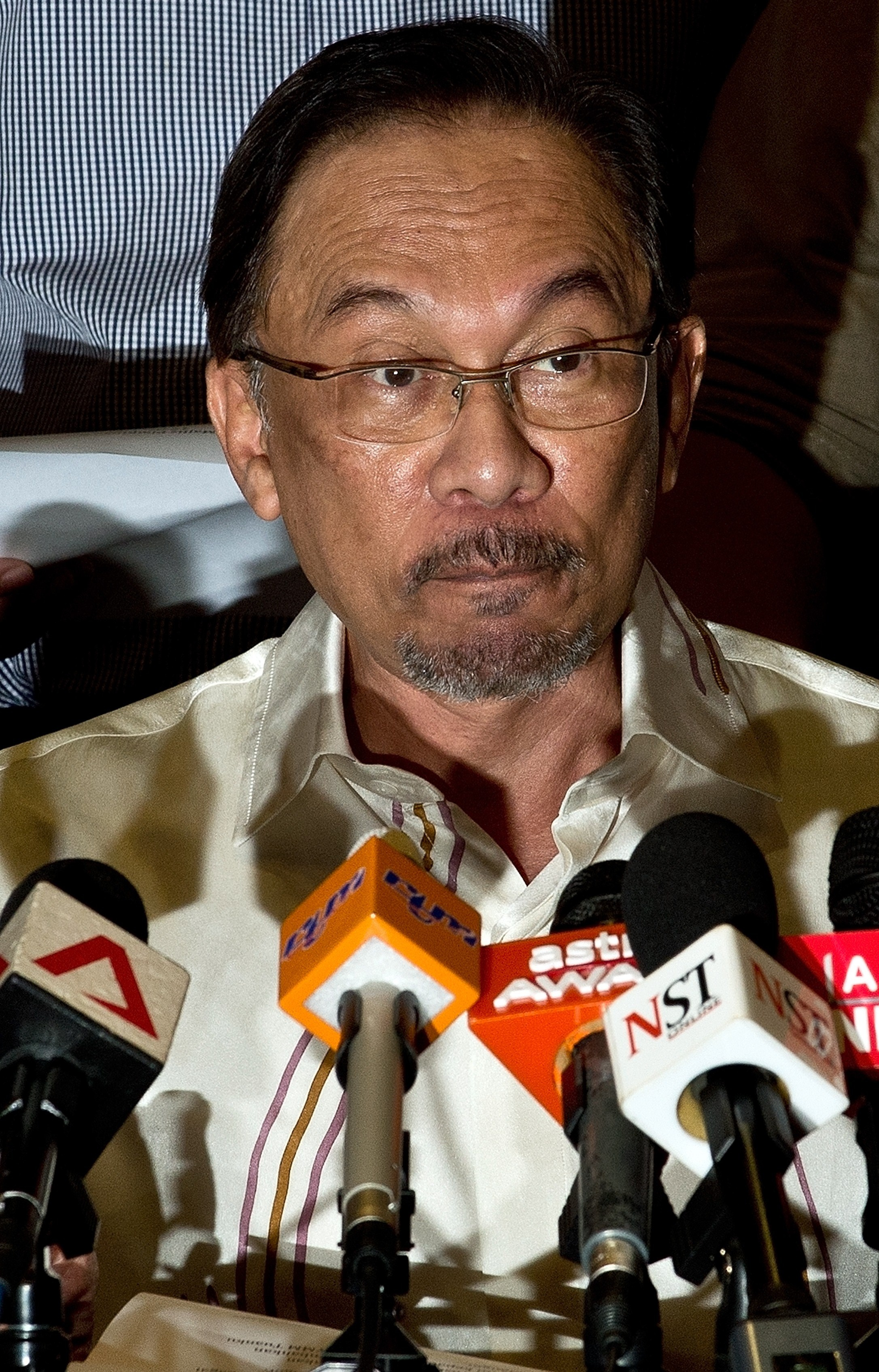 Malaysian opposition leader Anwar Ibrahim addresses the media after a meeting with senior Pan-Malaysian Islamic Party (PAS) leaders in Subang Jaya on Aug. 17, 2014.