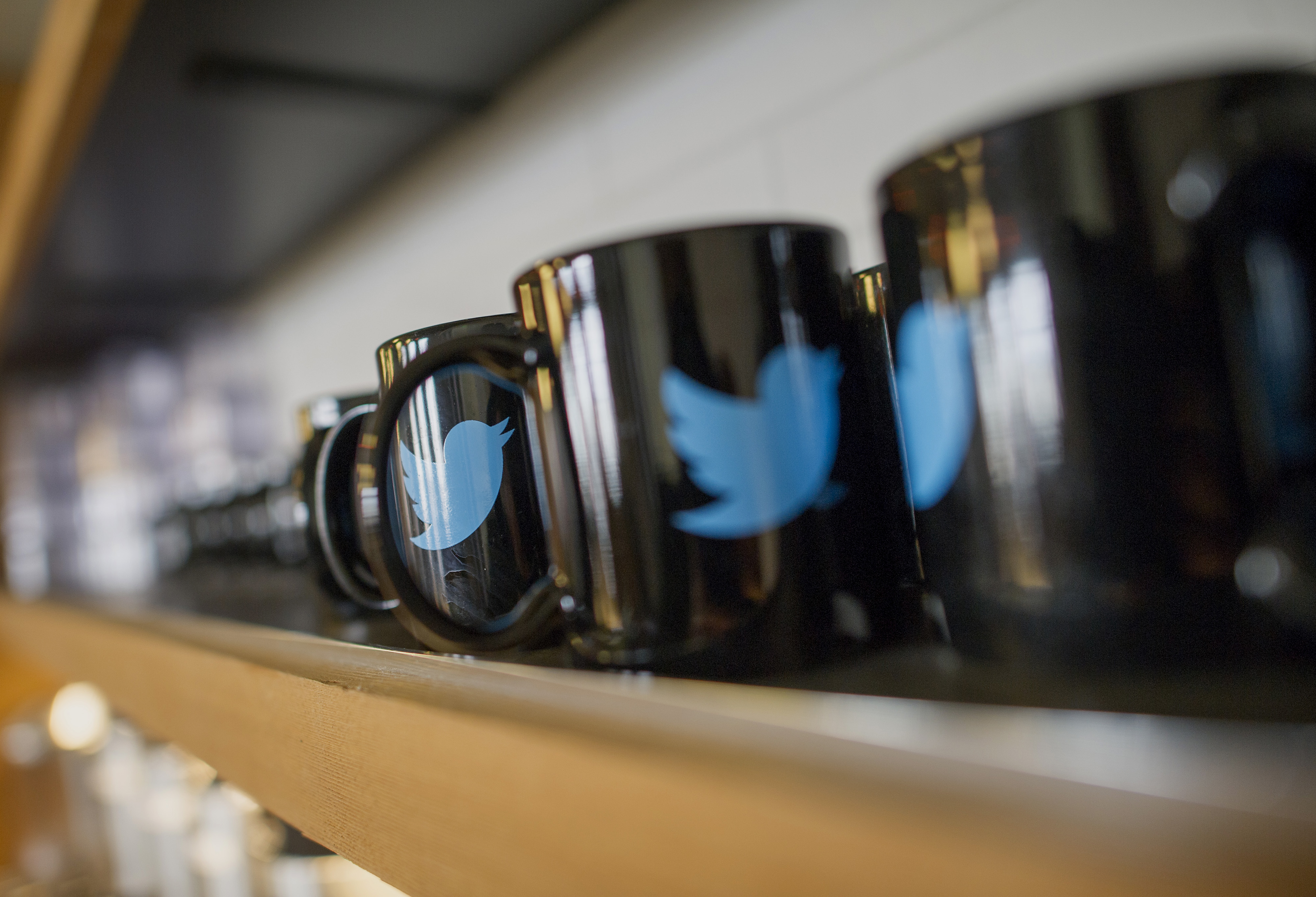 The Twitter Inc. logo is seen on coffee mugs inside the company's headquarters in San Francisco, California, U.S., on Friday, Sept. 19, 2014.