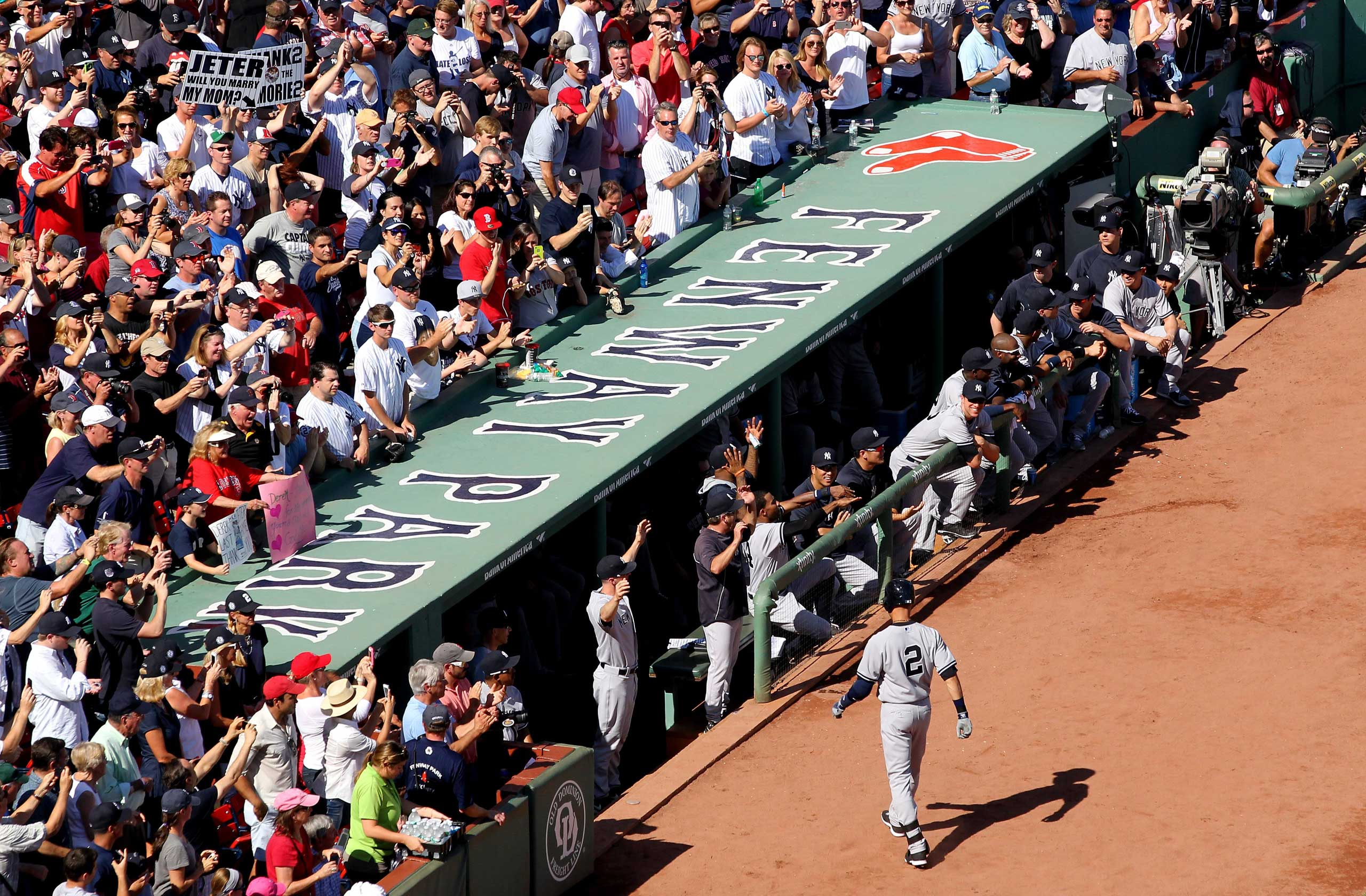 Sept. 28, 2014. Derek Jeter #2 of the New York Yankees returns to the dugout after batting in the first inning against the Boston Red Sox during the last game of the season at Fenway Park in Boston, Massachusetts.
