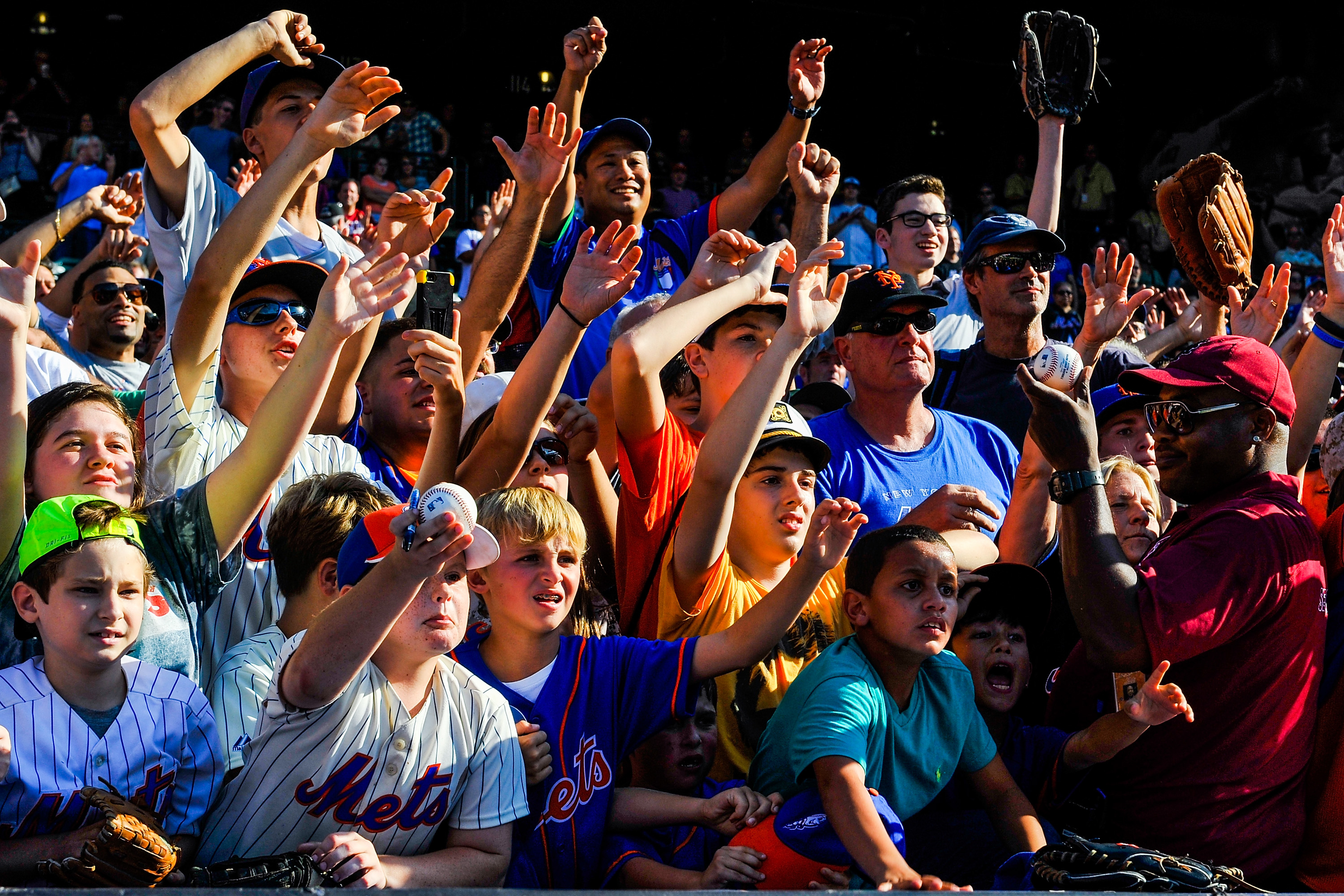 Children yell to players after a game between the New York Mets and Houston Astros at Citi Field on September 28, 2014 in the Flushing neighborhood of the Queens borough of New York City.