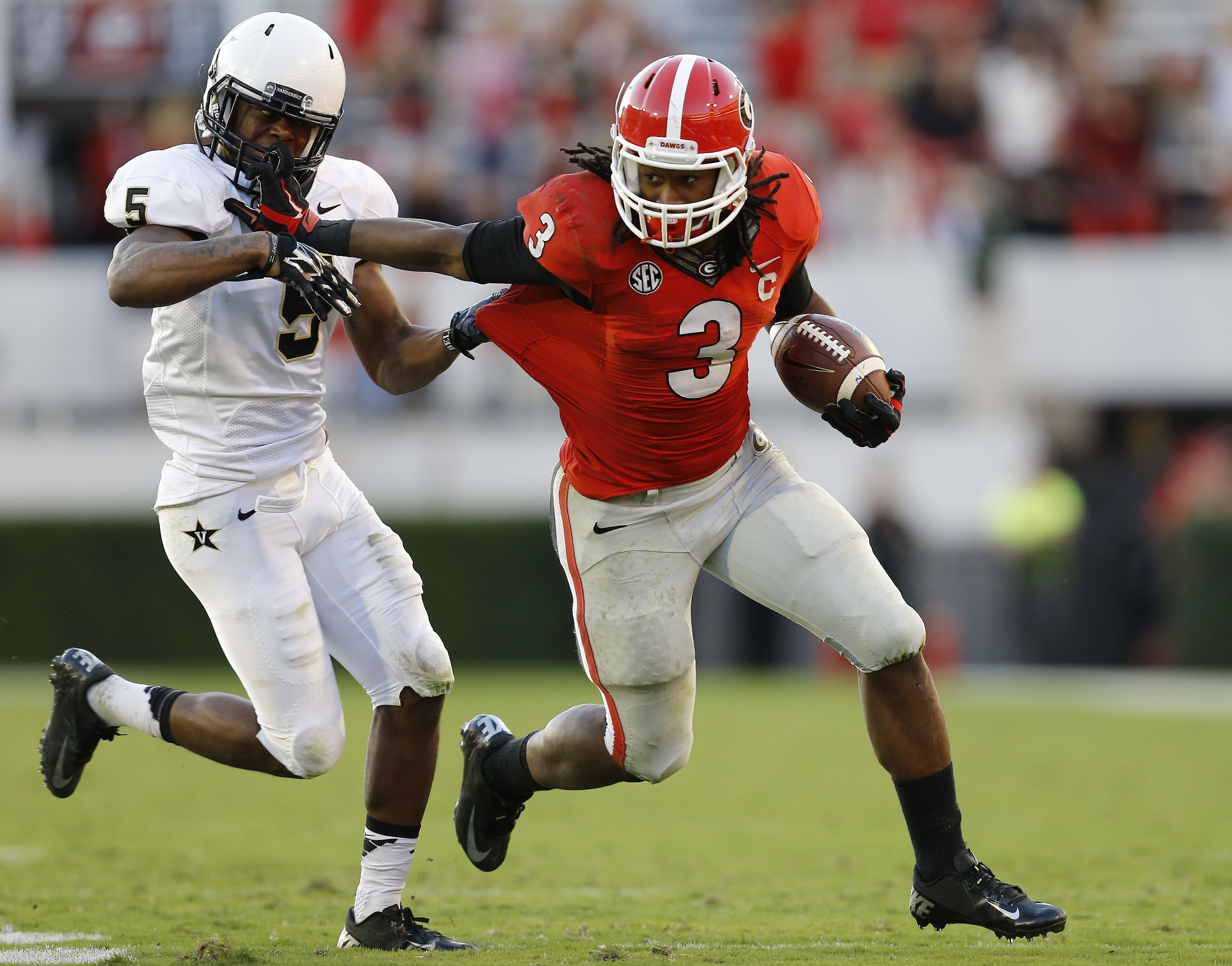 Georgia running back Todd Gurley (right) stiff-arms Torren McGaster of Vanderbilt on October 4, 2014 in Athens, Georgia.