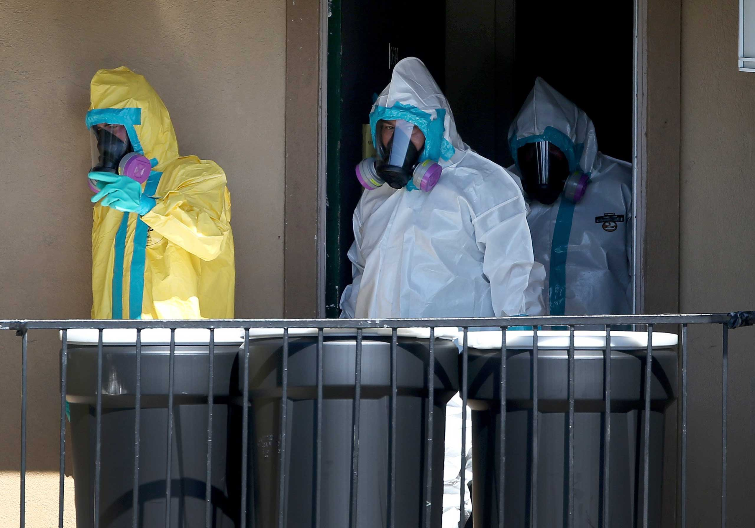 Members of the Cleaning Guys Haz Mat clean up company are seen as they sanitize the apartment where Ebola patient Thomas Eric Duncan was staying before being admitted to a hospital on Oct. 5, 2014 in Dallas.