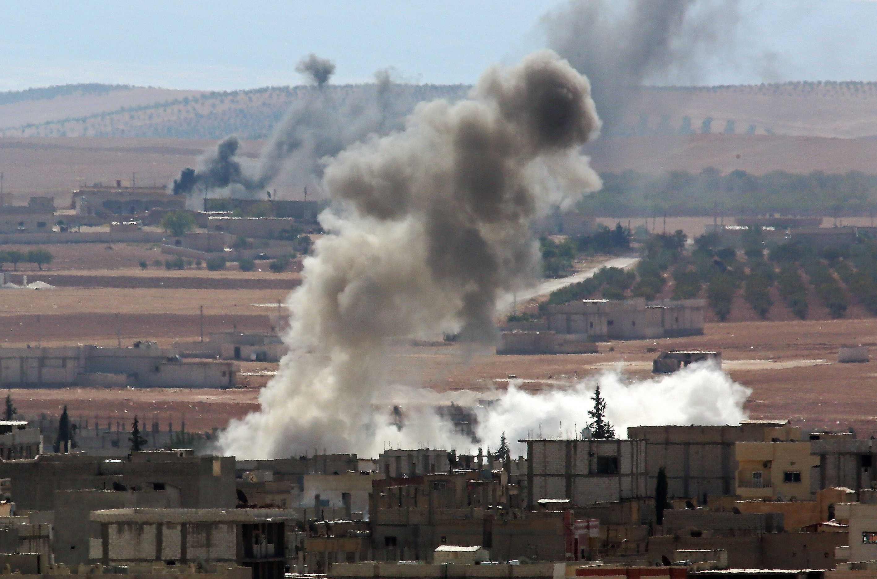 Smoke rising from the Syrian town of Kobani Thursday marks where clashes between its Kurdish defenders and ISIS attackers are underway.