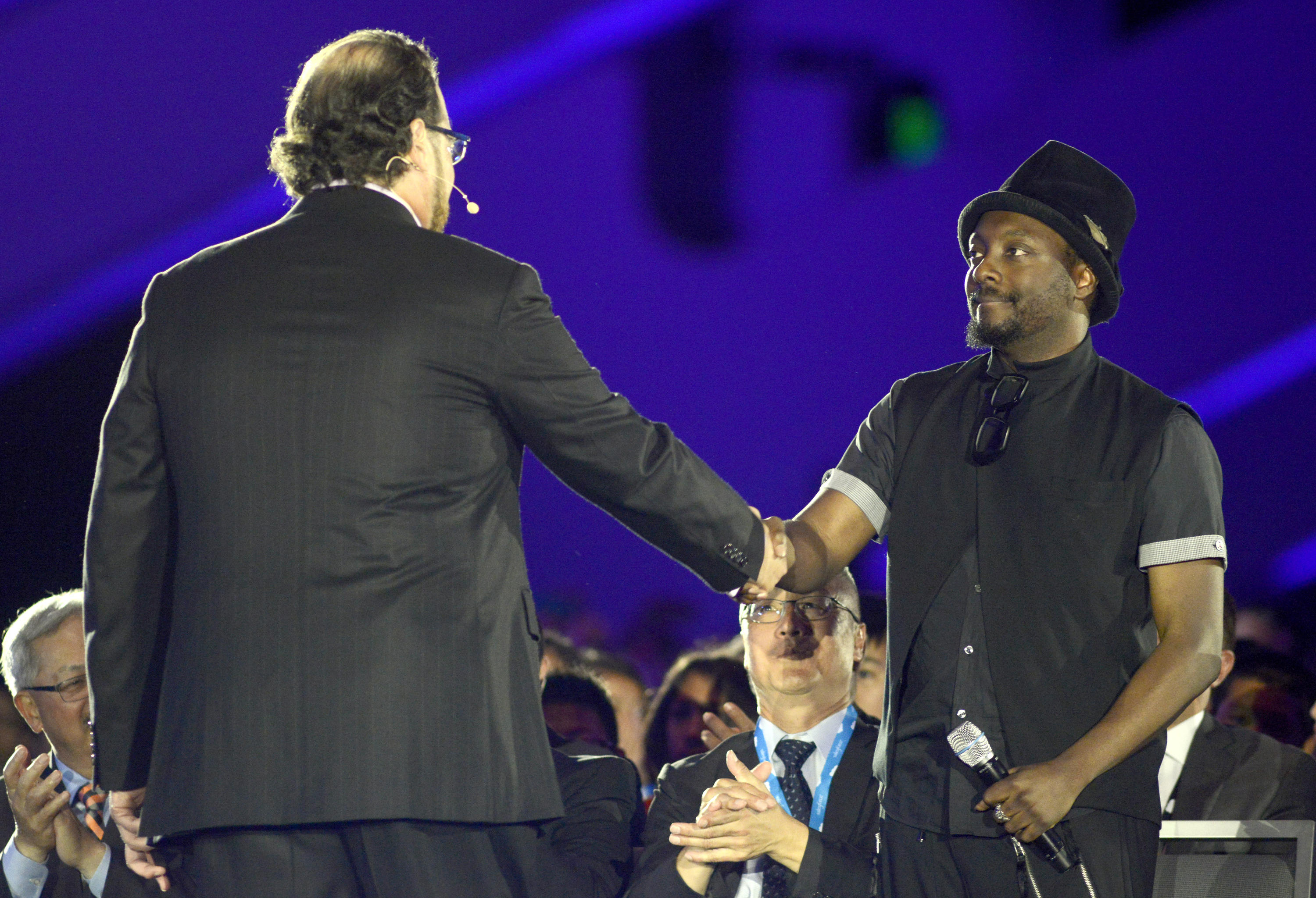 Marc Benioff (left) and will.i.am participate in the keynote speech at Salesforce.com's Dreamforce 2014 Conference.