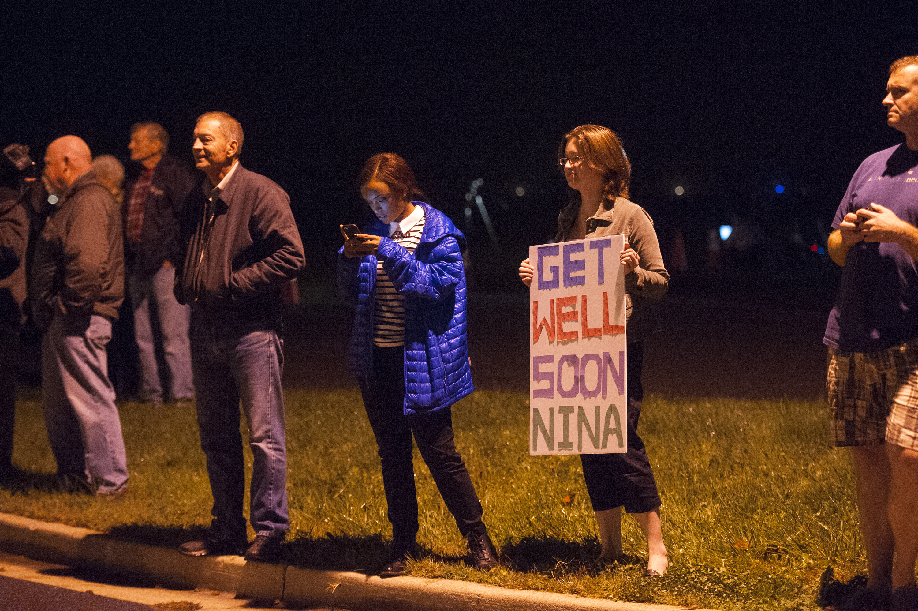 Ashley King of Walkersville came out to send a positive message to Nina Pham, a nurse who treated Thomas Duncan, the Liberian man, who died of Ebola,  who was flown into Frederick Airport and transferred to NIH to treat her now that she has Ebola October 16, 2014 in Frederick, Maryland.