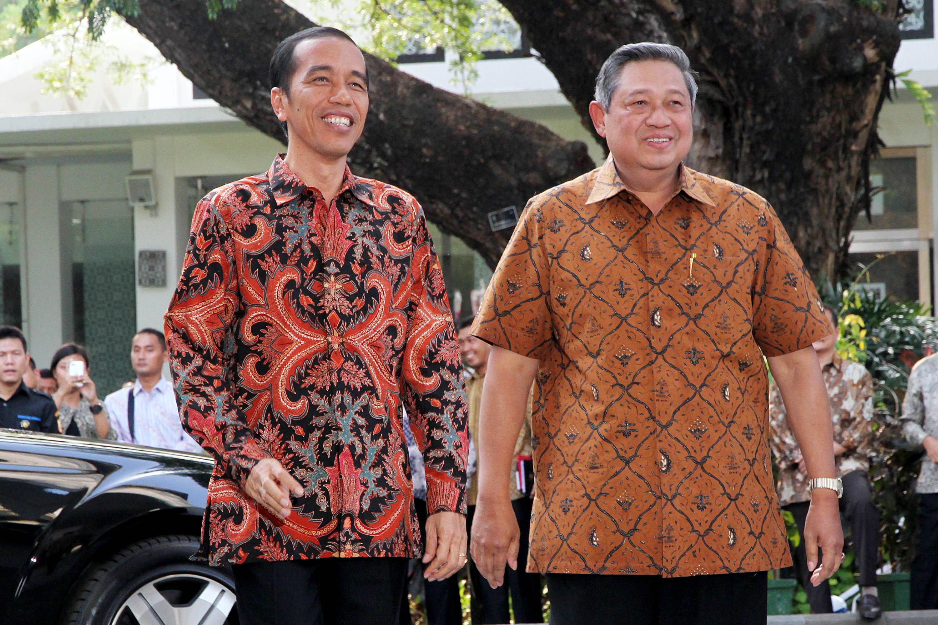 Incoming Indonesian President Joko Widodo, left, is greeted by outgoing president Susilo Bambang Yudhoyono during a visit at the presidential palace in Jakarta, Indonesia, on Oct. 19, 2014.