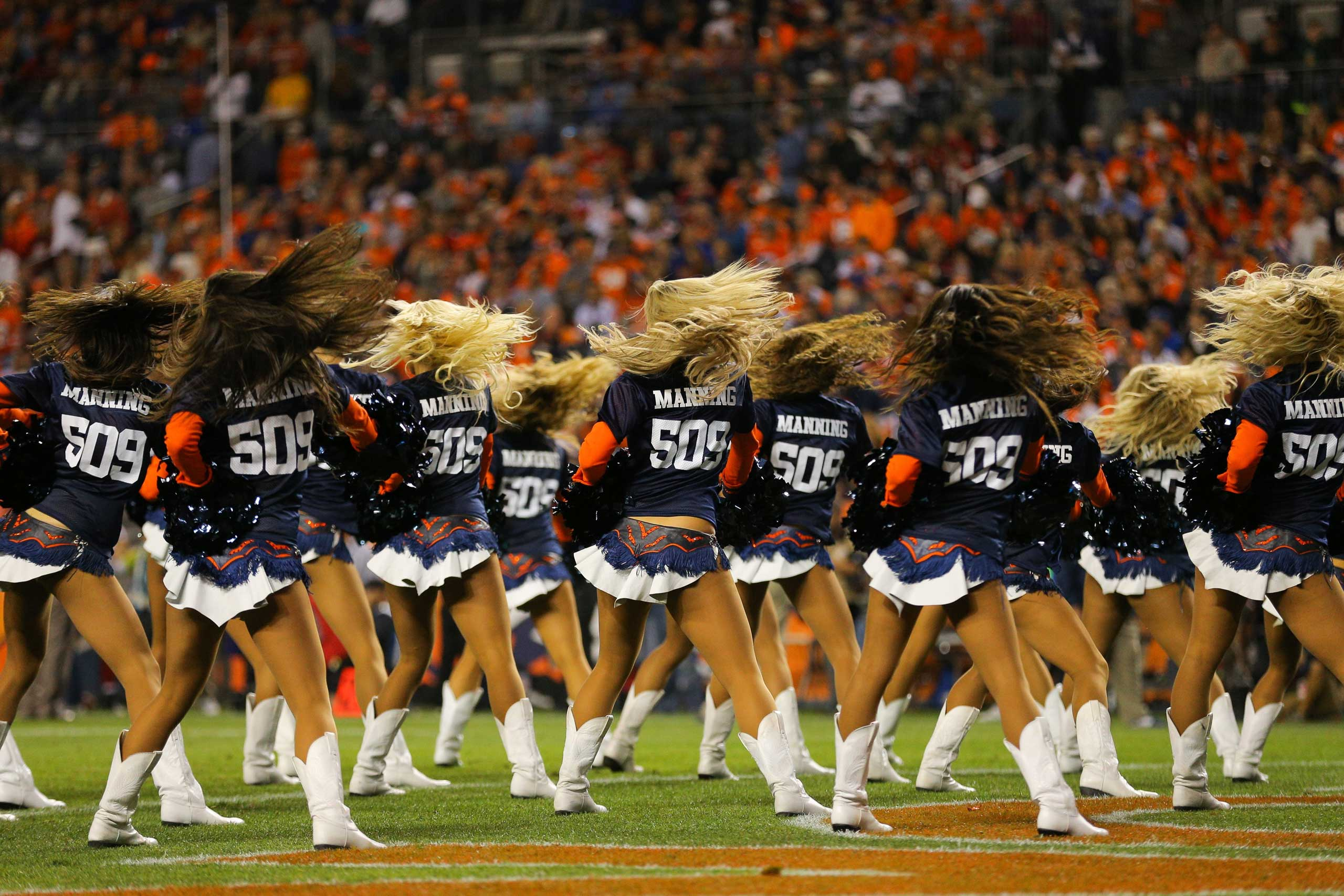 Oct. 19, 2014. Denver Broncos cheerleaders perform wearing  509  jerseys celebrating quarterback Peyton Manning's record setting 509th career touchdown pass during a game between the Denver Broncos and the San Francisco 49ers at Sports Authority Field at Mile High in Denver, Col.