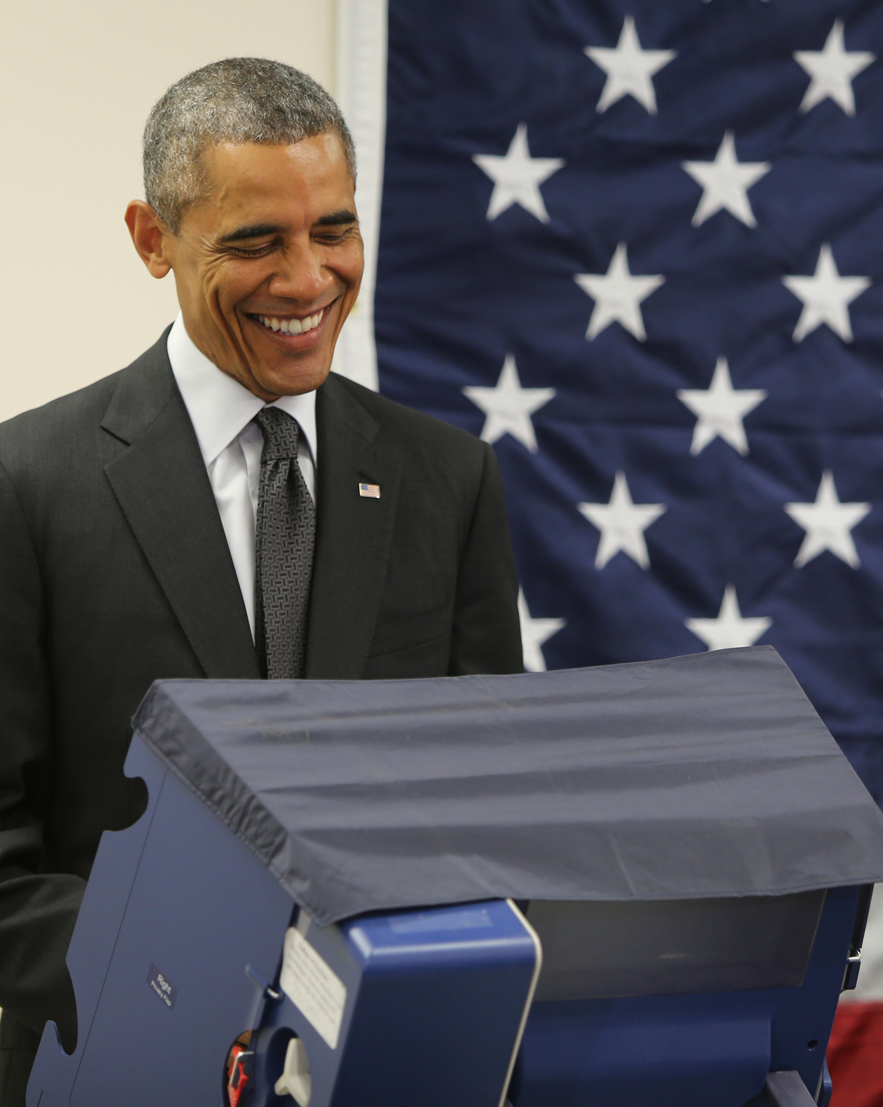 President Barack Obama casts his early votes at Dr. Martin Luther King Community Center in Chicago Monday, Oct. 20, 2014.