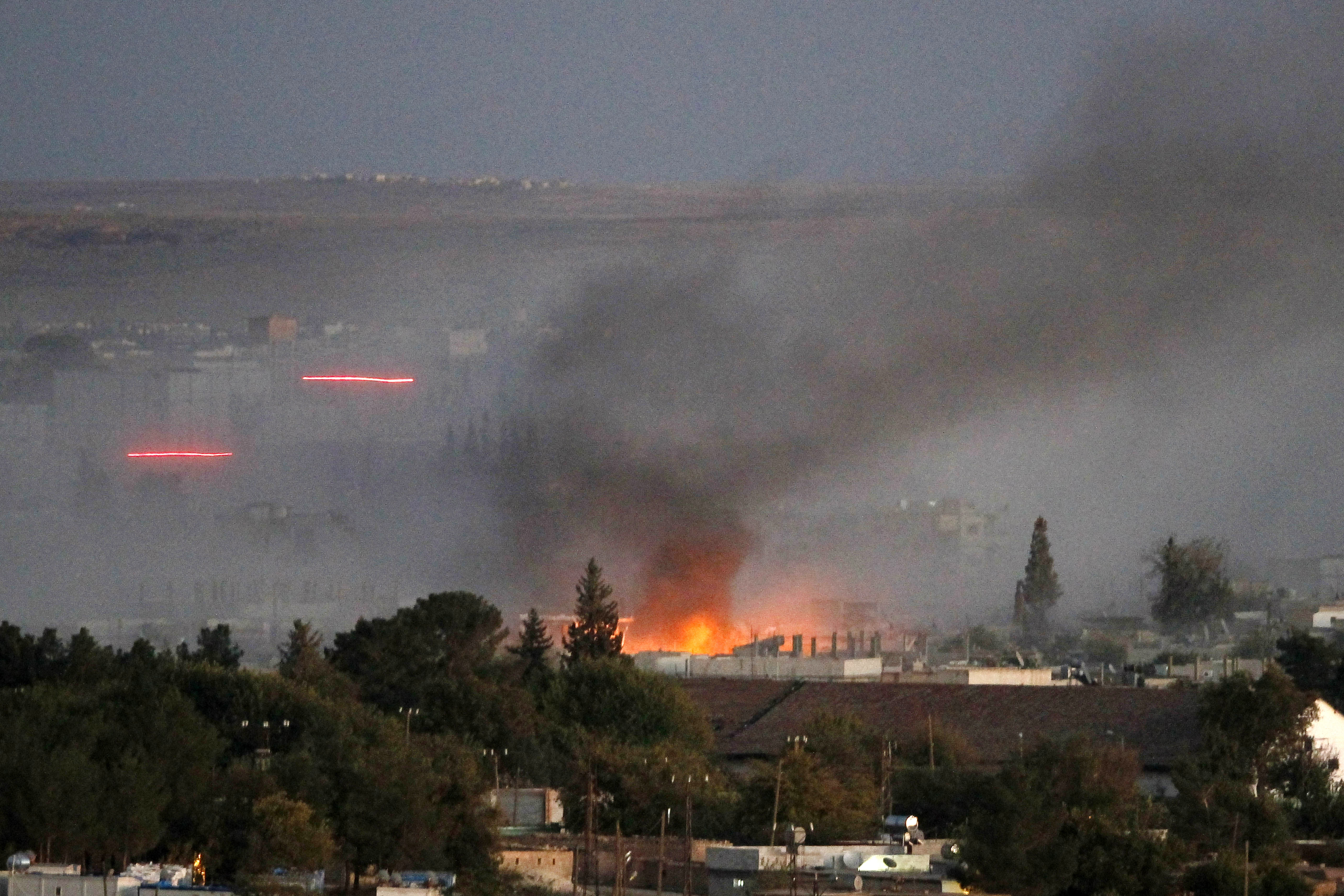 Smoke rises through the air after an explosion rocks Syrian city of Kobane  on October 20, 2014.