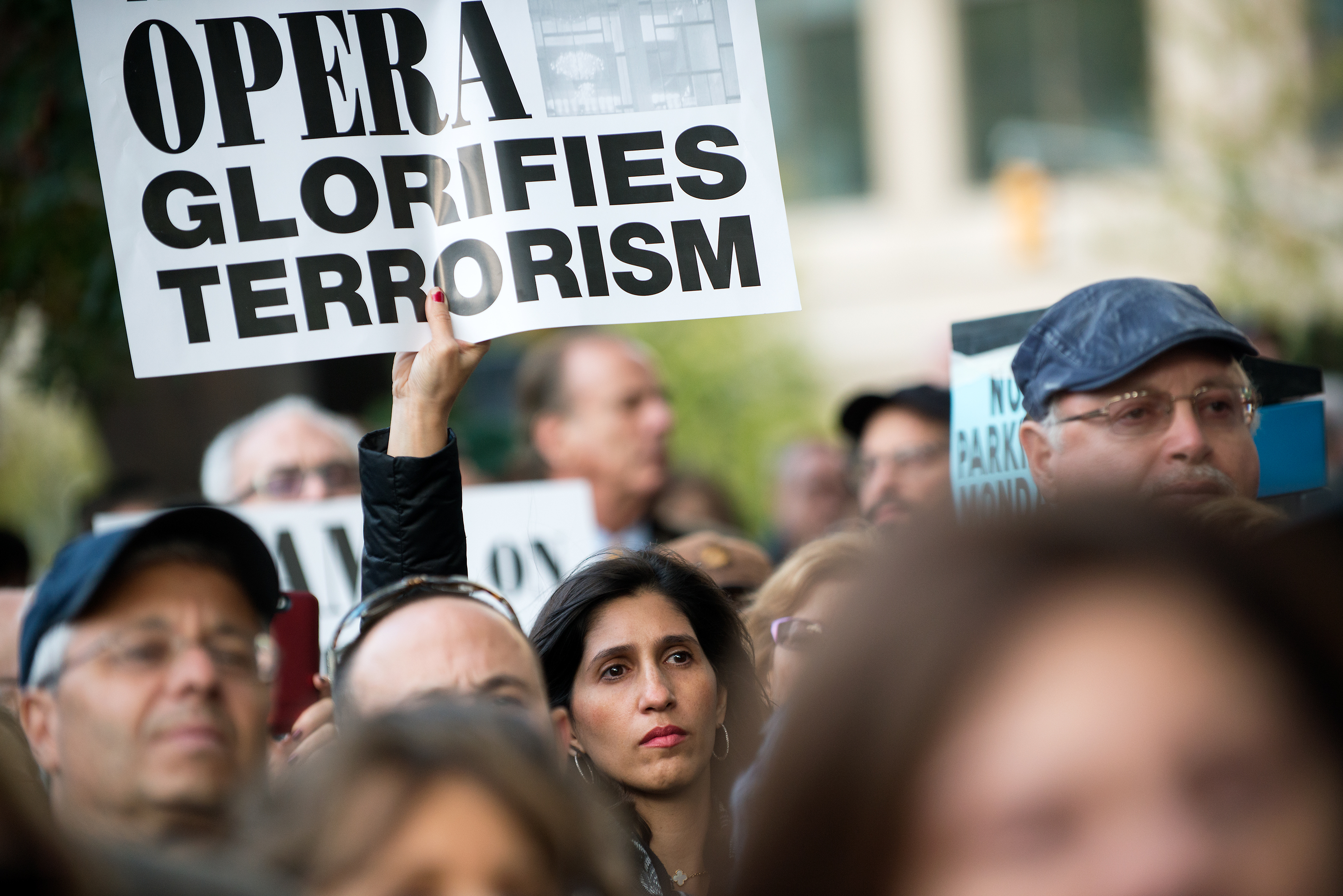 A protestor holds up a sign outside the Metropolitan Opera at Lincoln Center on opening night of the opera,  The Death of Klinghoffer  on October 20, 2014 in New York City. The opera, by John Adams, depicts the death of Leon Klinghoffer, a Jewish cruise passenger from New York, who was killed and dumped overboard during a 1985 hijacking of an Italian cruise ship by Palestinian terrorists.