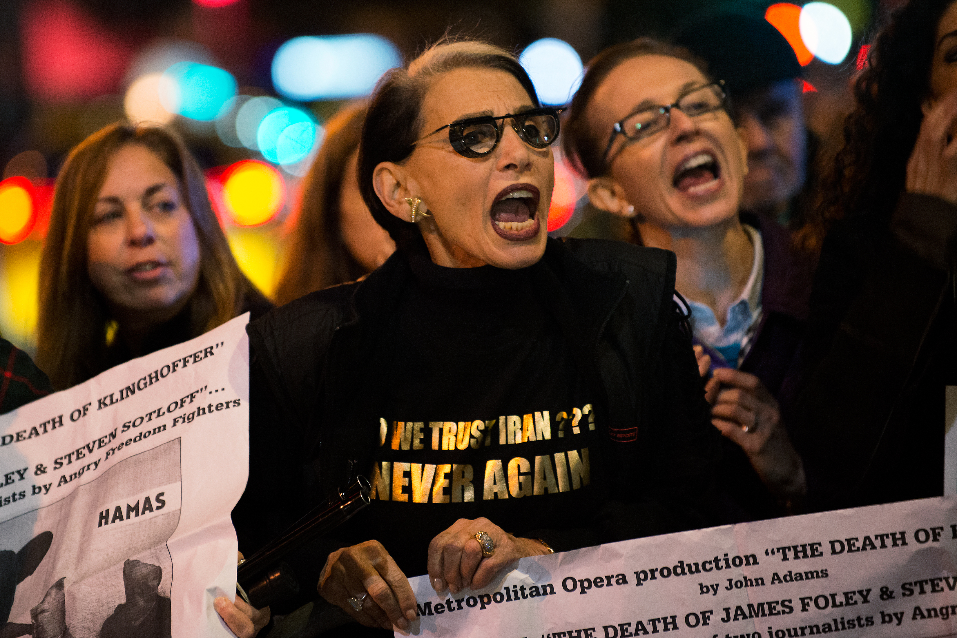 Protestors yell at counter-protestors and opera attendees at the Metropolitan Opera at Lincoln Center on opening night of the opera,  The Death of Klinghoffer  on October 20, 2014 in New York, NY.