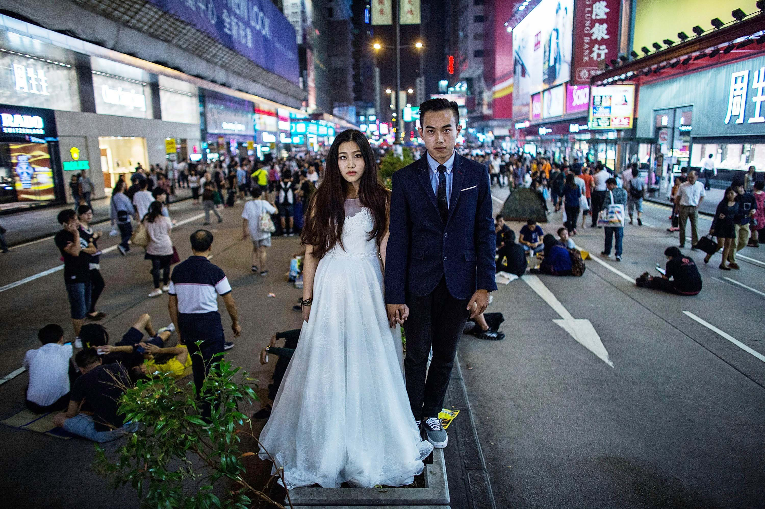 A Chinese couple takes pre-wedding photos at the occupation zone at Mongkok on Oct. 21, 2014 in Hong Kong.
