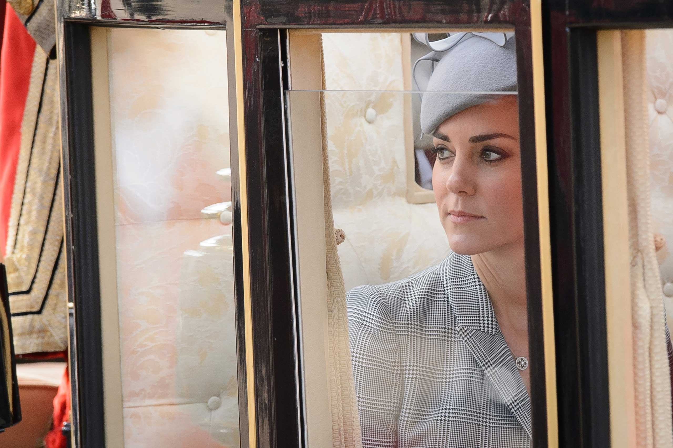 Oct. 21, 2014.  Britain's Catherine, Duchess of Cambridge, takes her seat in a State Carriage for the procession to Buckingham Palace as part of the welcome ceremony for Singapore's President Tony Tan Keng Yam at the start of a state visit at Horse Guards Parade in London, England.  The President is at the beginning of his four day stay during which he will hold a bilateral meeting with Prime Minister David Cameron.