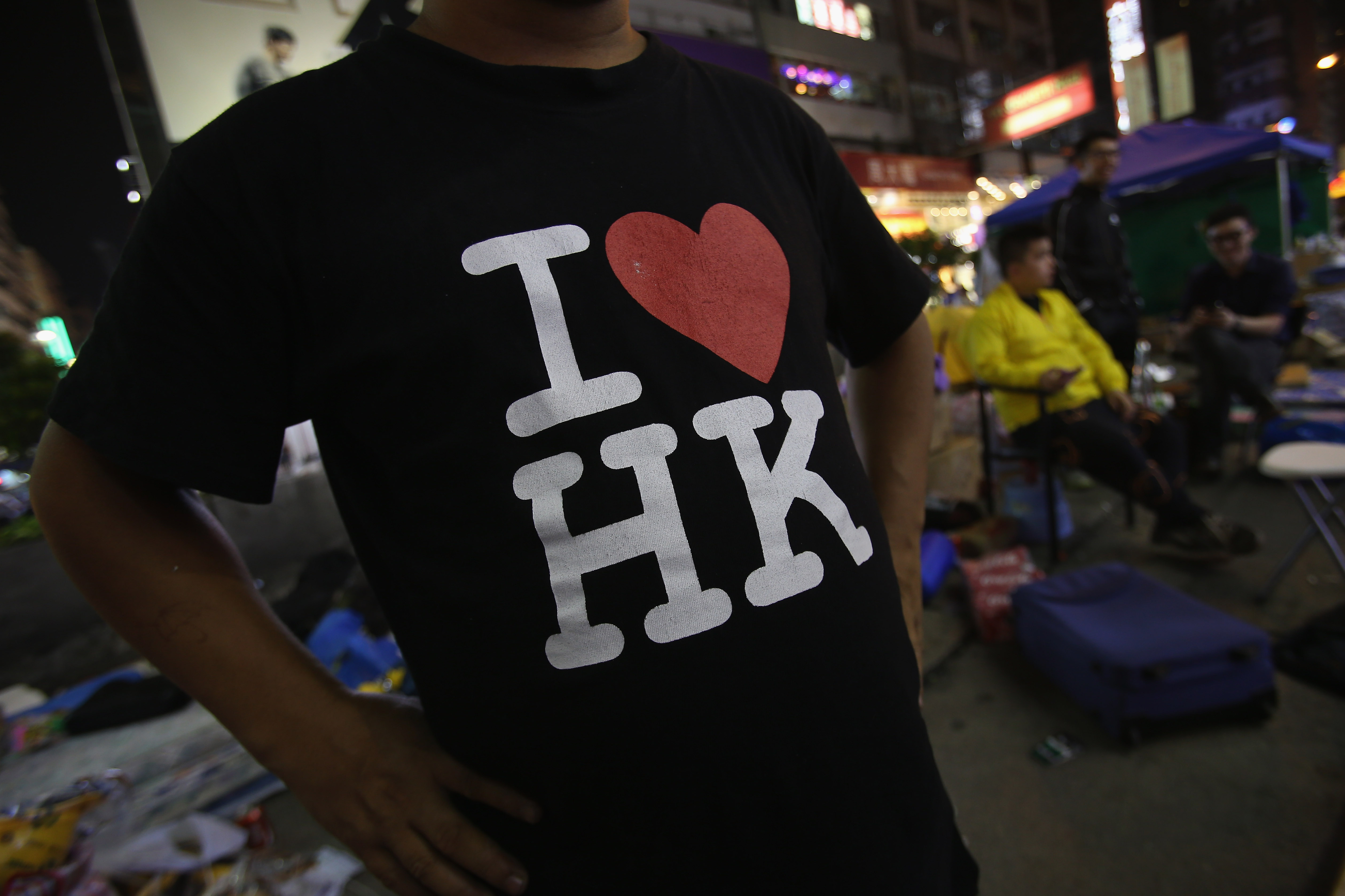 A pro-democracy protester displays his T-shirt on a street in Mongkok district on October 22, 2014 in Hong Kong.