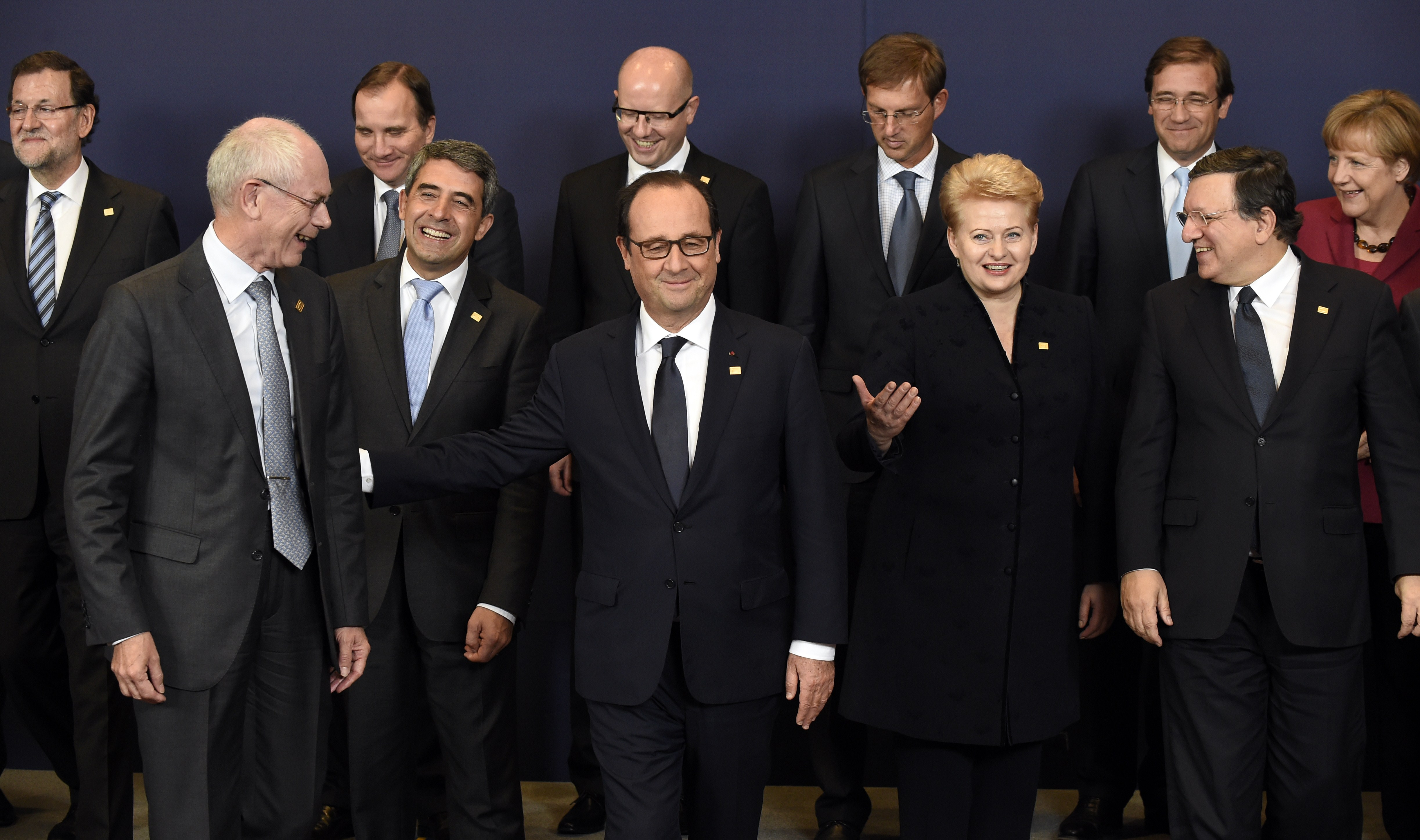 European heads of state and government (from back left) Spanish Prime Minister Mariano Rajoy, Swedish Prime Minister Stefan Loefven, Czech Prime Minister Bohuslav Sobotka, Slovenian Prime Minister Miro Cerar, Portuguese Prime Minister Pedro Passos Coelho and German Chancellor Angela Merkel (from front left) European Council President Herman Van Rompuy, Bulgarian President  Rosen Plevneliev, French President  Francois Hollande, Lithuanian President Dalia Grybauskaite and European Commission President Jose Manuel Barroso talk before a family photo during a European Union summit at the EU headquarters in Brussels on Oct 23, 2014.