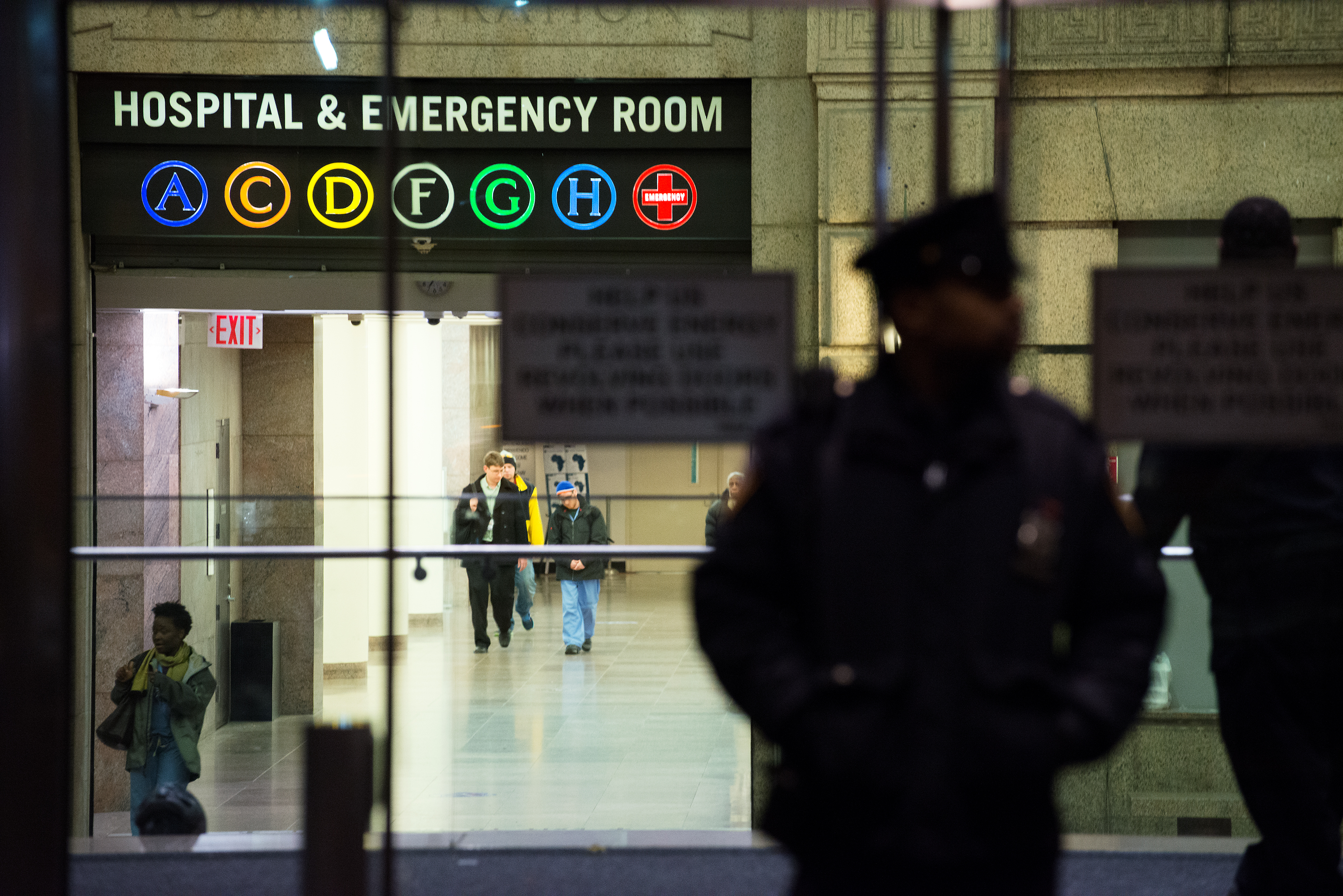 A New York City Police officer stands at the entrance to Bellevue Hospital October 23, 2014 in New York City.