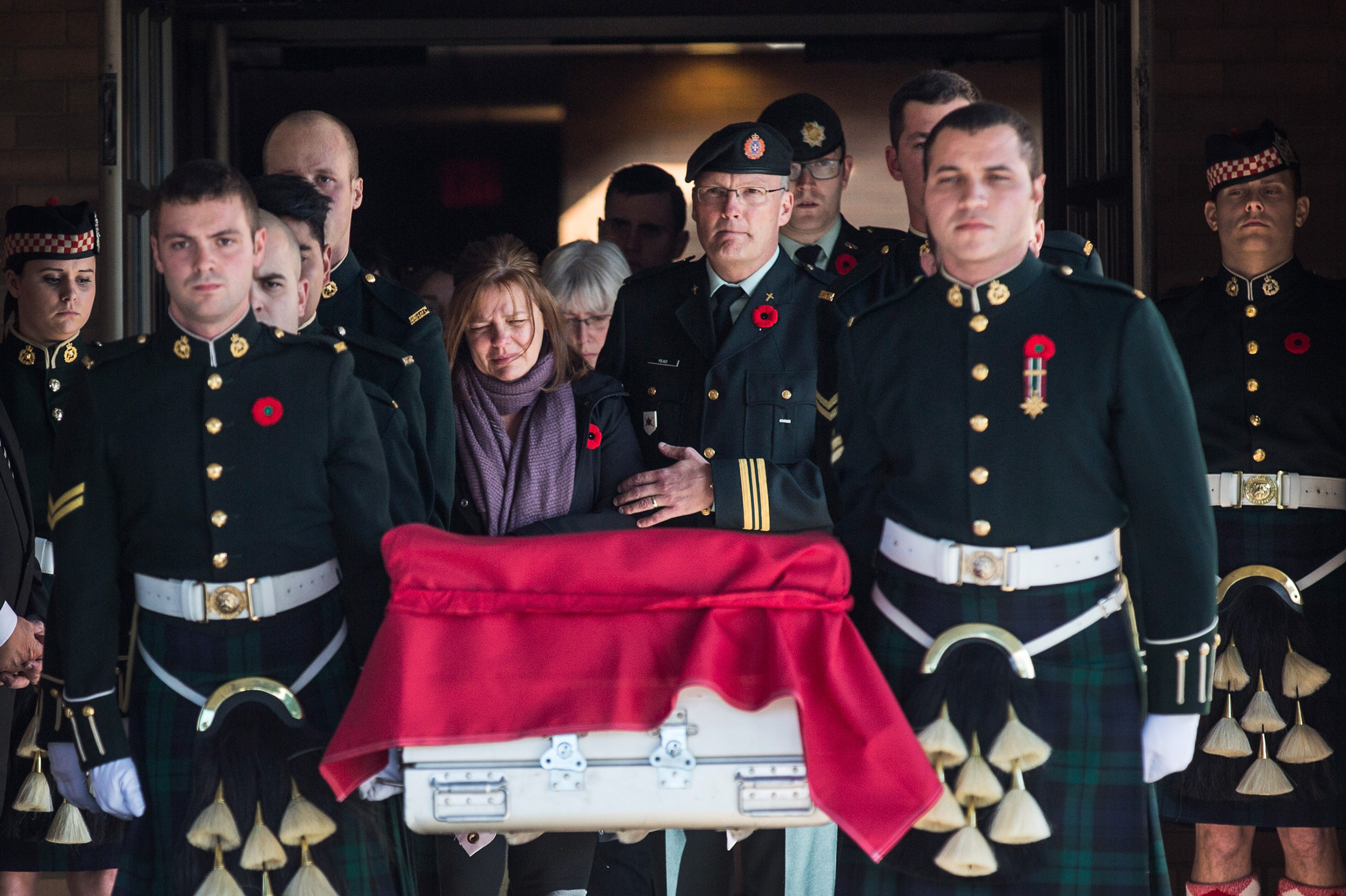 Oct. 24, 2014. Kathy Cirillo (center left), the mother of Cpl. Nathan Cirillo, follows the casket carrying her son, two days after he was shot dead by a gunman while he guarded the National War Memorial, during a precession from Ottawa to Cirillo's hometown of Hamilton, Ontario, in Ottawa, Canada.