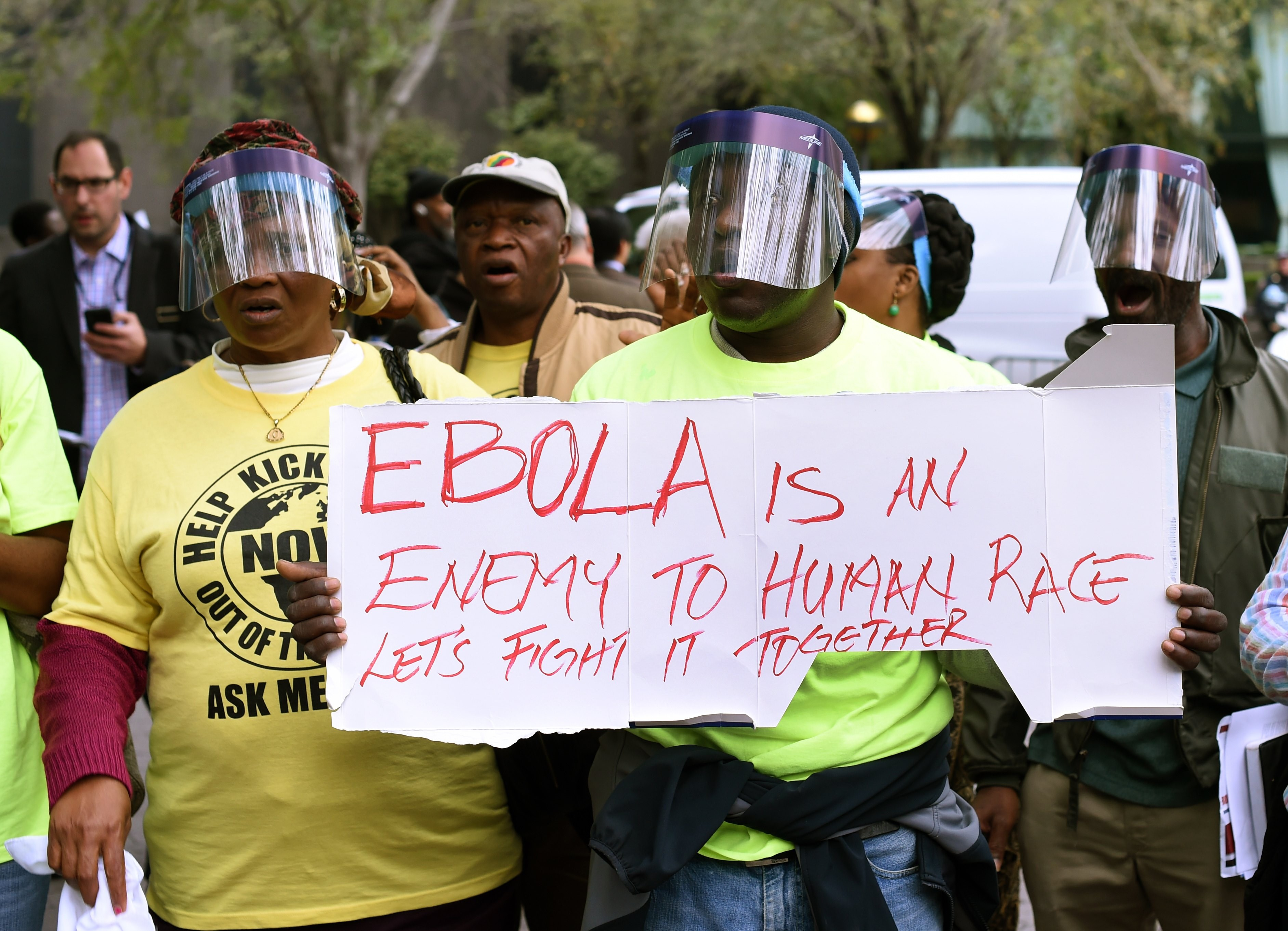 Demonstrators with the United African Congress (UAC) hold a rally for the  Stop Ebola  movement in New York on October 24, 2014 the morning after it was confirmed that Doctor Craig Spencer, a member of Doctors Without Borders, who recently returned to New York from West Africa tested positive for Ebola, making him New York City's first Ebola patient.