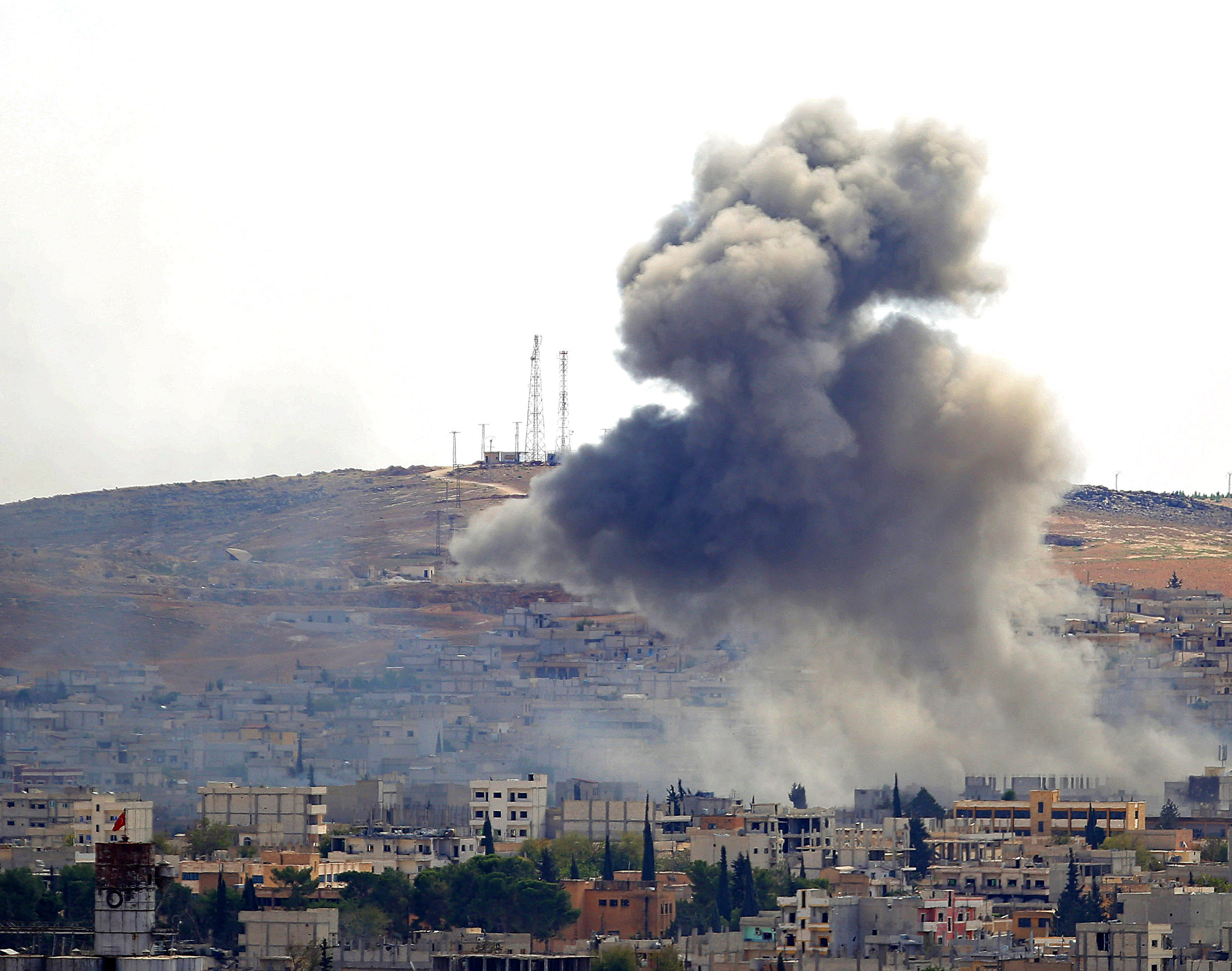 Smoke rises from the Syrian town of Kobani following a U.S.-led air strike on Sunday.