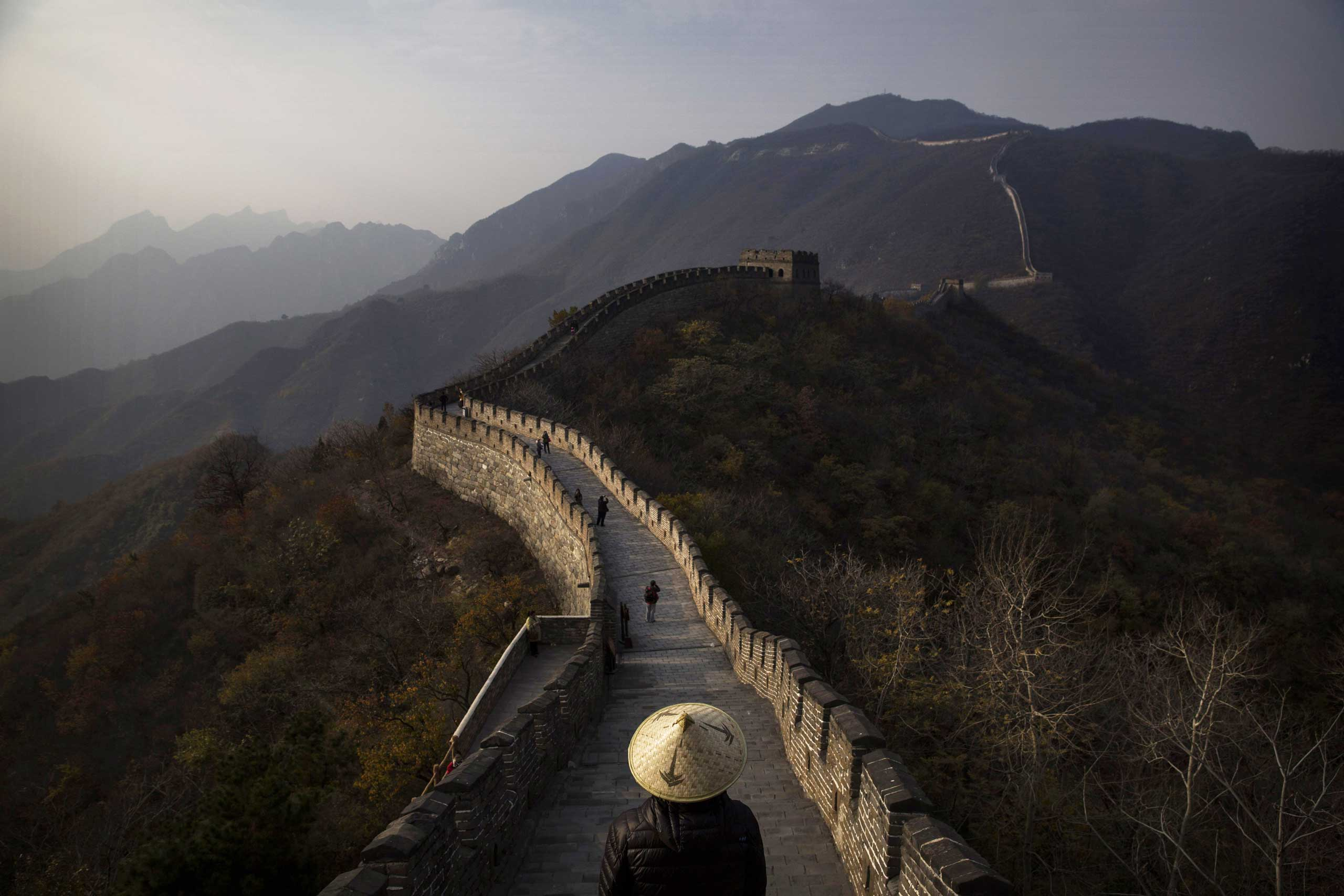 Oct. 28, 2014. Chinese and foreign tourists walk on a section of the Great Wall of China in Mutianyu, near Beijing.