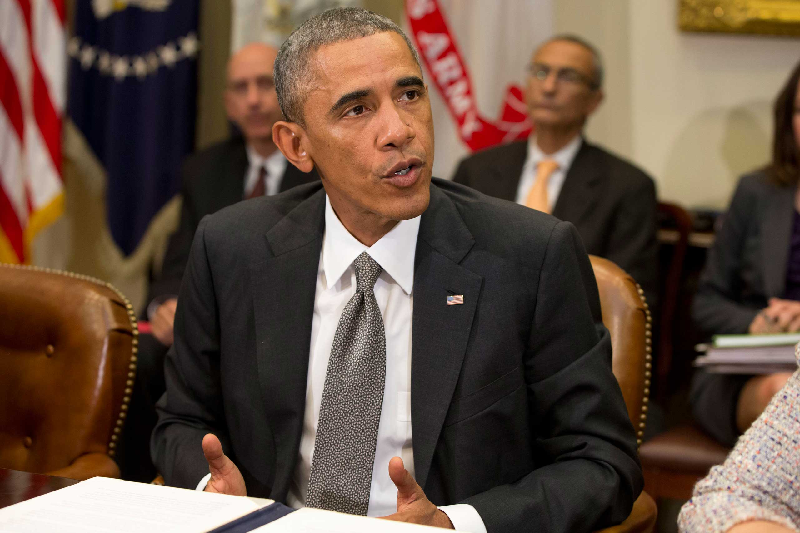 President Barack Obama meets with members of his national security team and senior staff to receive an update on the Ebola outbreak in West Africa, Oct. 6, 2014, in the Roosevelt Room of the White House in Washington.