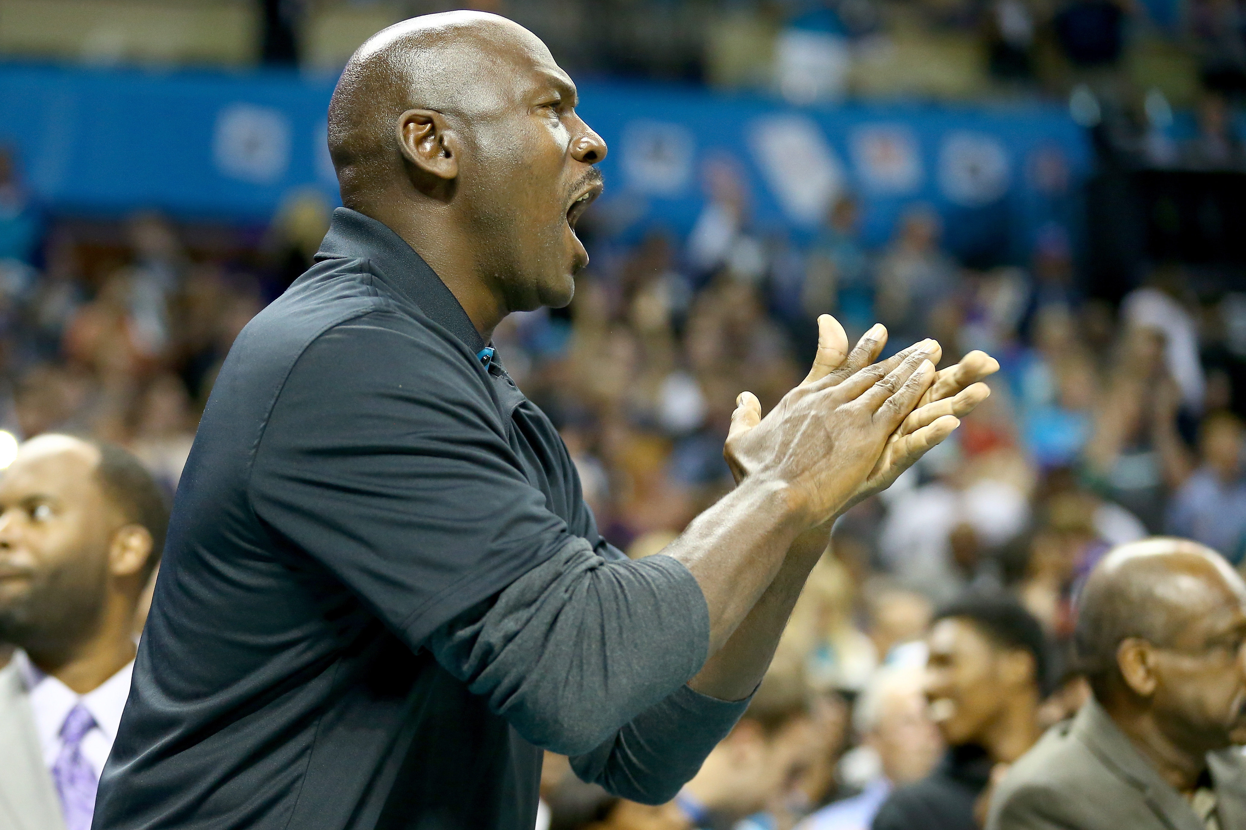 Michael Jordan, owner of the Charlotte Hornets, watches on during their game against the Milwaukee Bucks at Time Warner Cable Arena on October 29, 2014 in Charlotte, North Carolina.