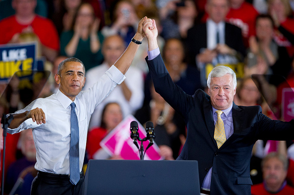 President Barack Obama and Democratic Representative Mike Michaud raise their hands at the Democratic candidate's gubernatorial-election campaign rally in Portland, Maine, on Oct. 30, 2014