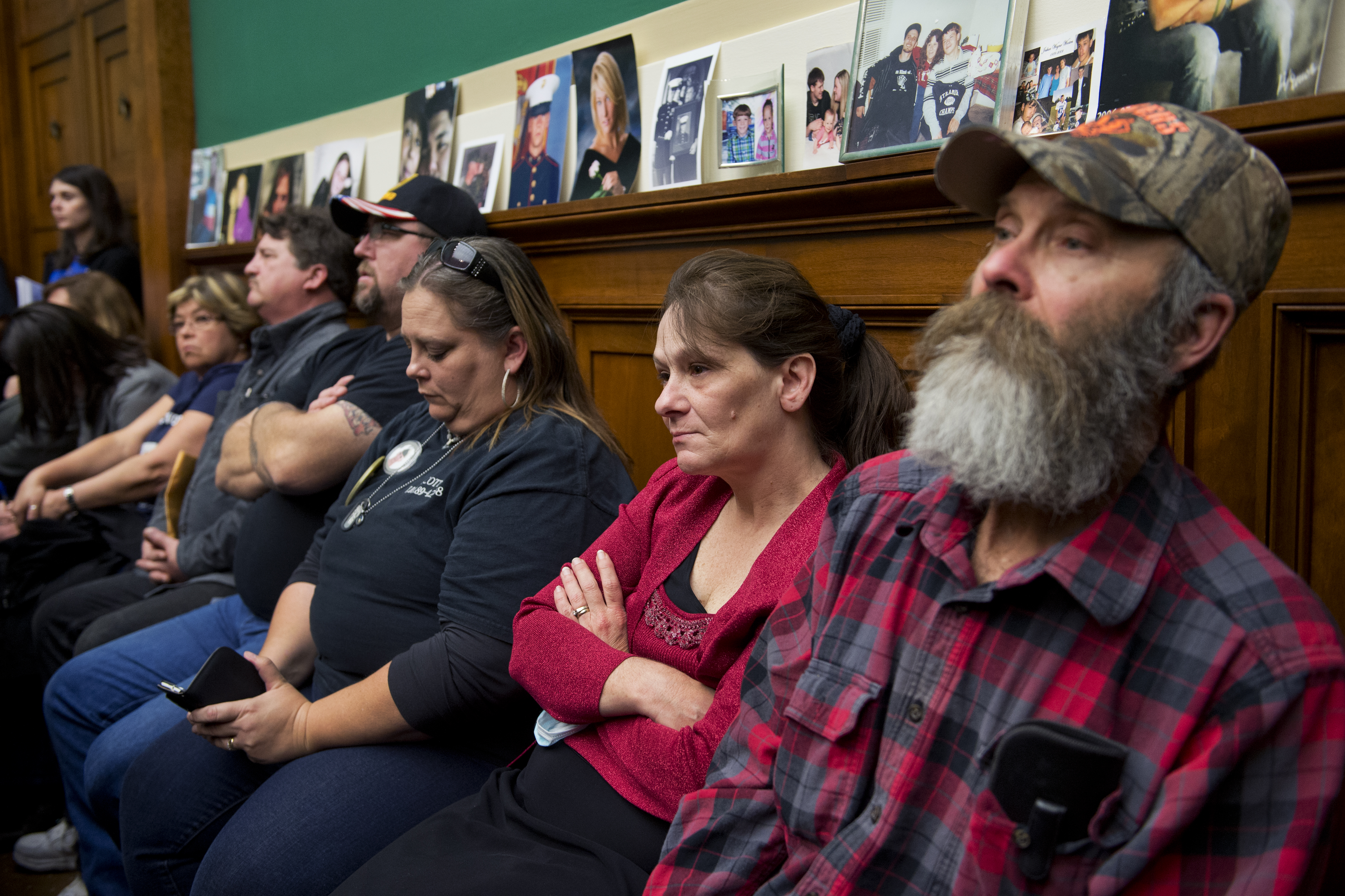 Family members of people killed due to a faulty ignition switch watch a House hearing on April 1, 2014.