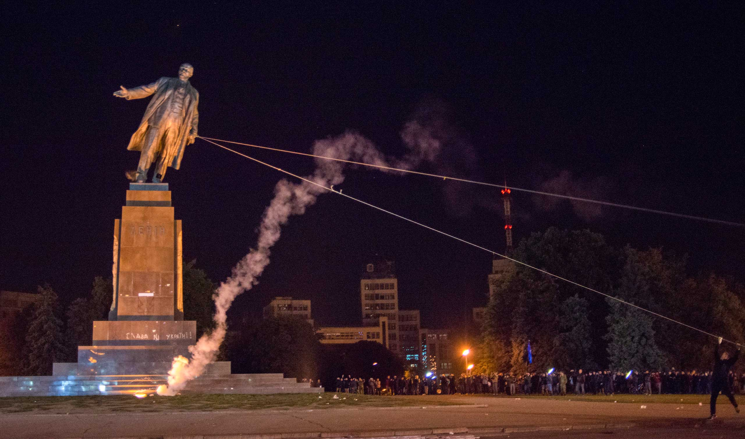 Sept. 28, 2014. Activists dismantle Ukraine's biggest monument to Lenin at a pro-Ukrainian rally in the central square of the eastern city of Kharkiv, Ukraine.