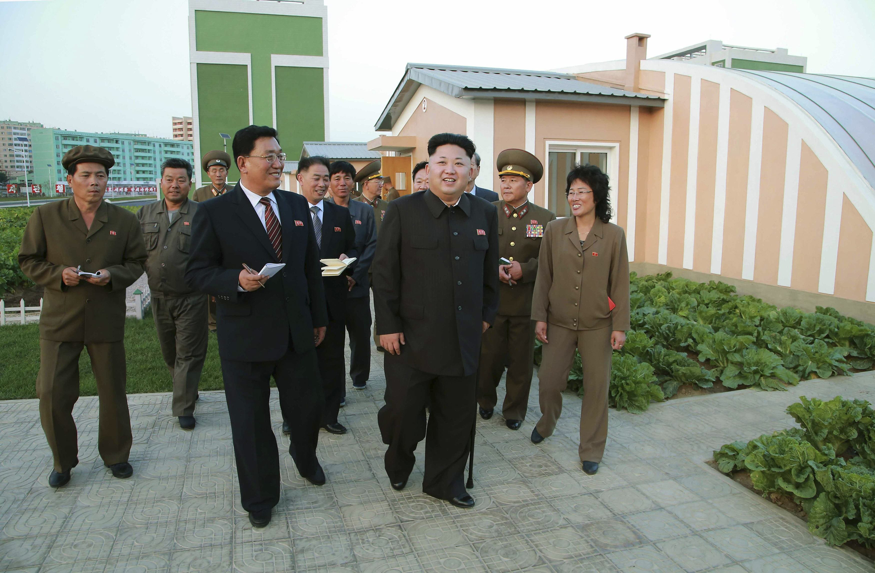 North Korean leader Kim Jong Un gives field guidance at the newly built Wisong Scientists Residential District in this undated photo in Pyongyang, released on Oct. 14, 2014.
