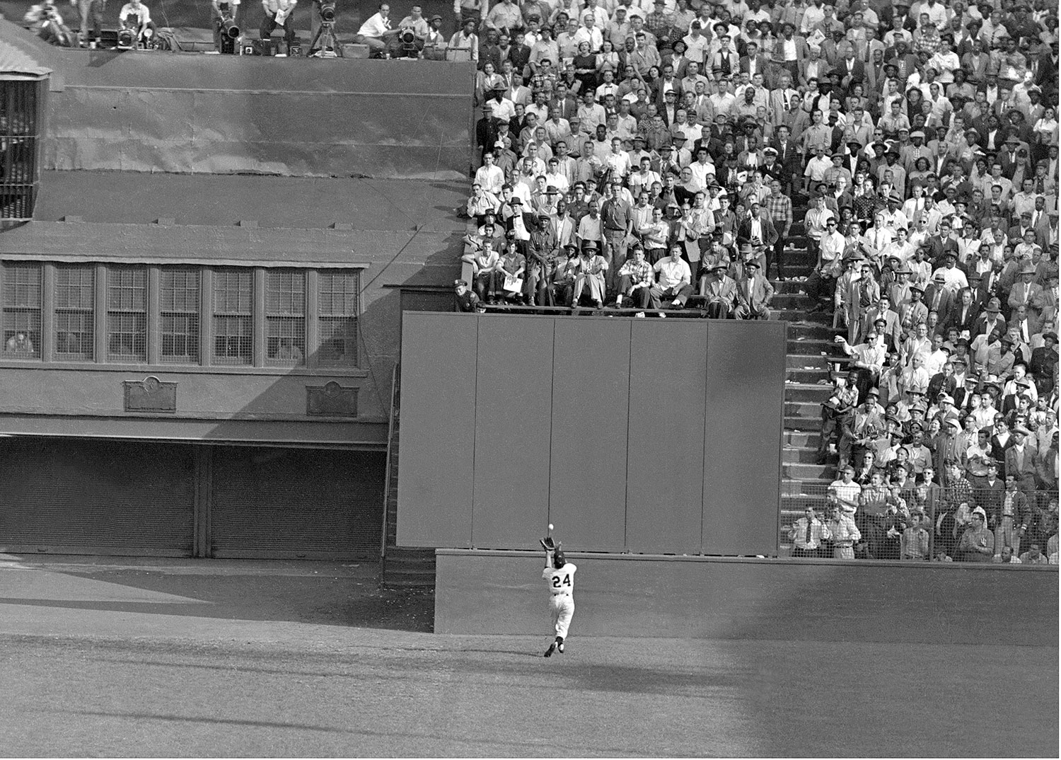 "Sept. 29, 1954: Willie Mays of the New York Giants makes ""The Catch"" against the Clevland Indians in Game 1 -- considered one of the most spectacular catches in World Series history."