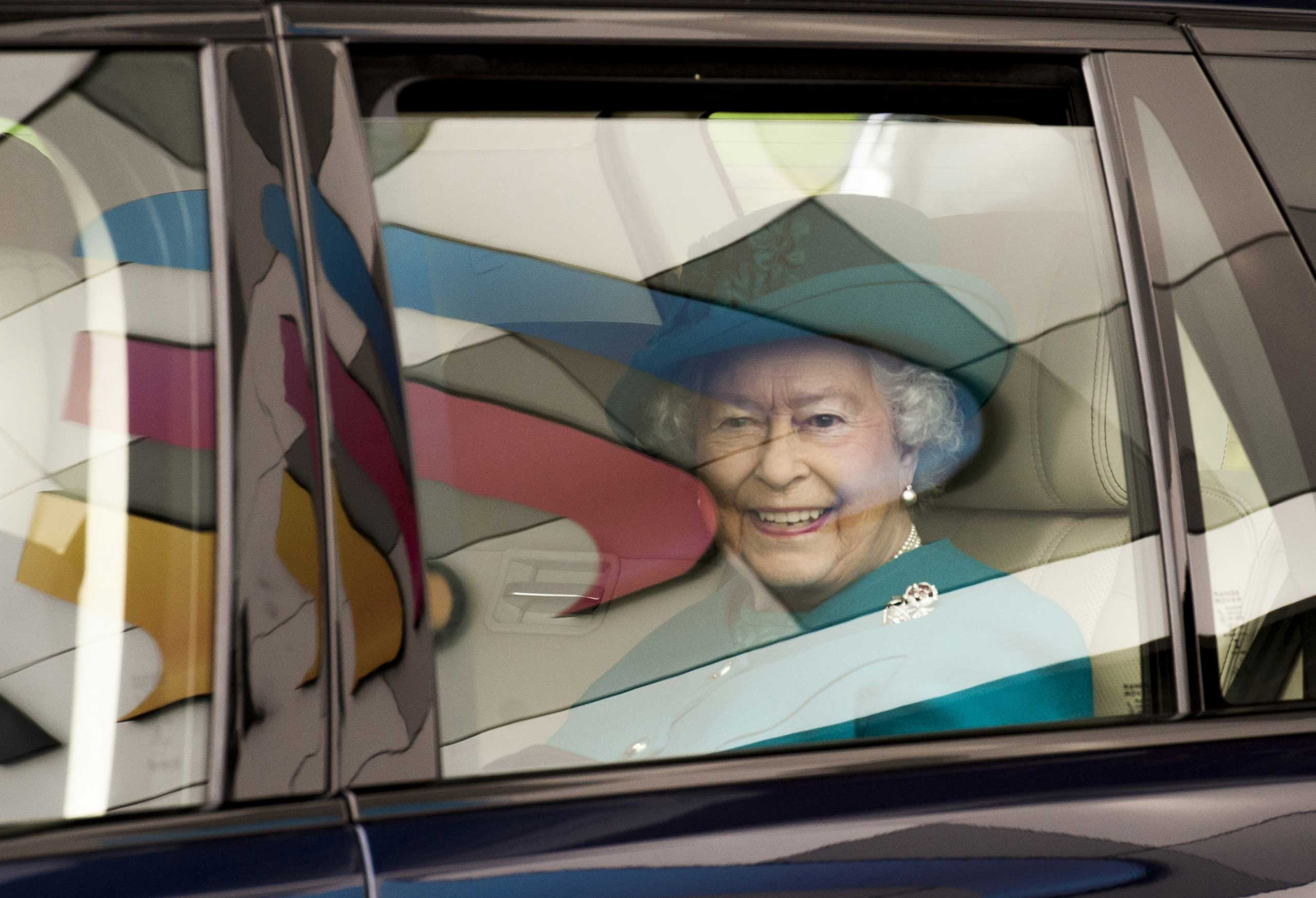 Oct. 30, 2014. Queen Elizabeth II leaves following an official visit to International Security Printers to view their work on specialist postage stamps in Wolverhampton, U.K.
