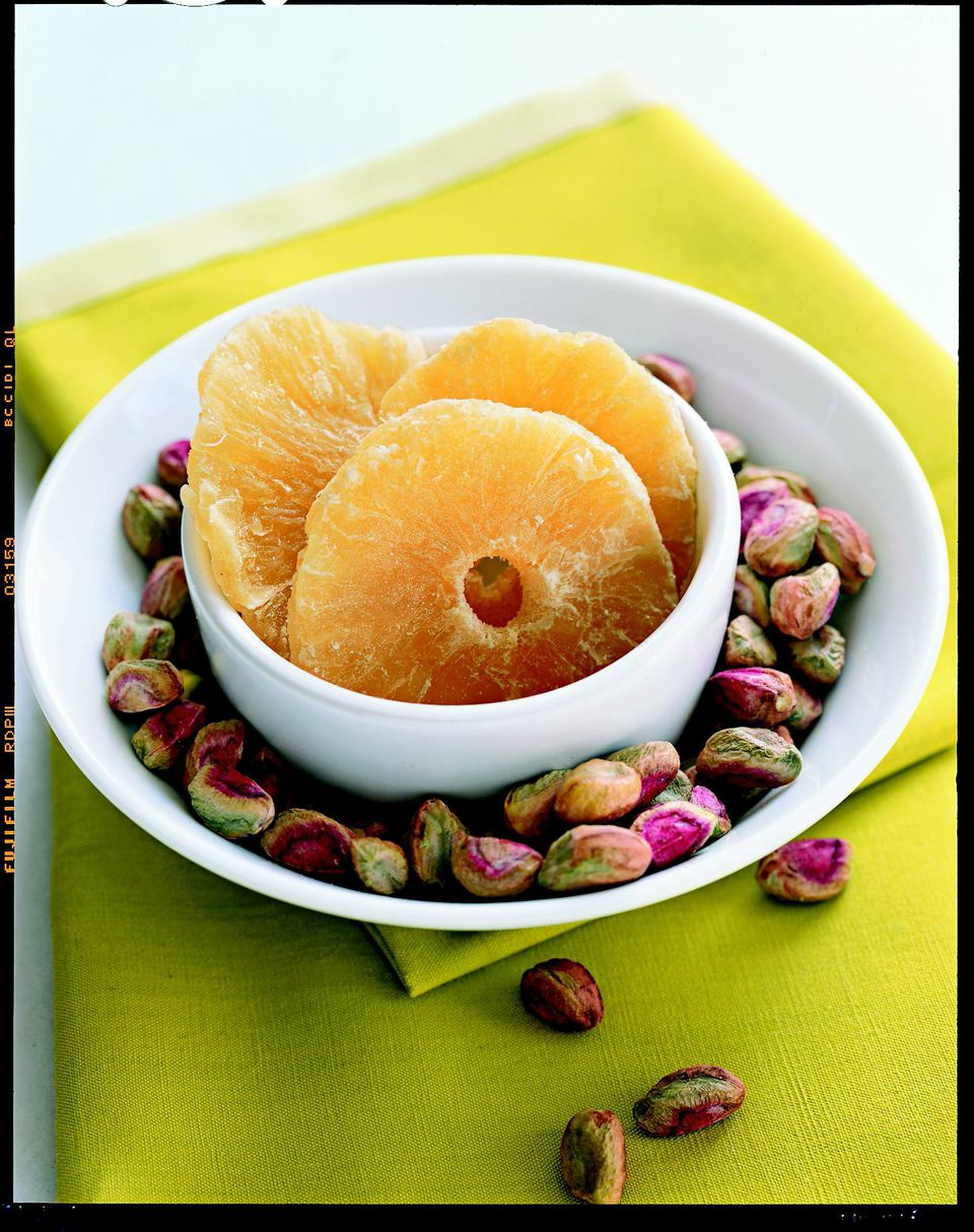 3. Pineapple and Pistachios Combine about ¼ cup dried pineapple pieces with about 25 pistachio nuts. (For a treat, use chile-lime pistachio nuts, available at specialty stores.) Other winning dried-fruit-and-nut combos: raisins and peanuts, apricots and almonds, cherries and hazelnuts.                                                              Health bonus: Pineapple and nuts are both good sources of antioxidants.