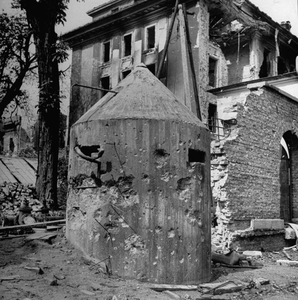 <b>Not published in LIFE.</b> Bullet-riddled sentry pillbox outside Hitler's bunker, Berlin, 1945.