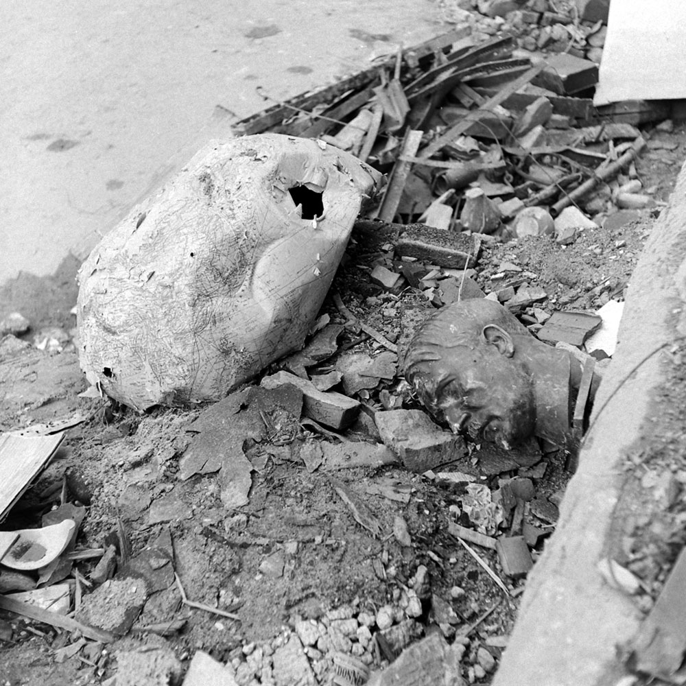 <b>Not published in LIFE.</b> An image almost too perfectly symbolic of Berlin in 1945: A crushed globe and a bust of Hitler amid rubble outside the ruined Reich Chancellery.