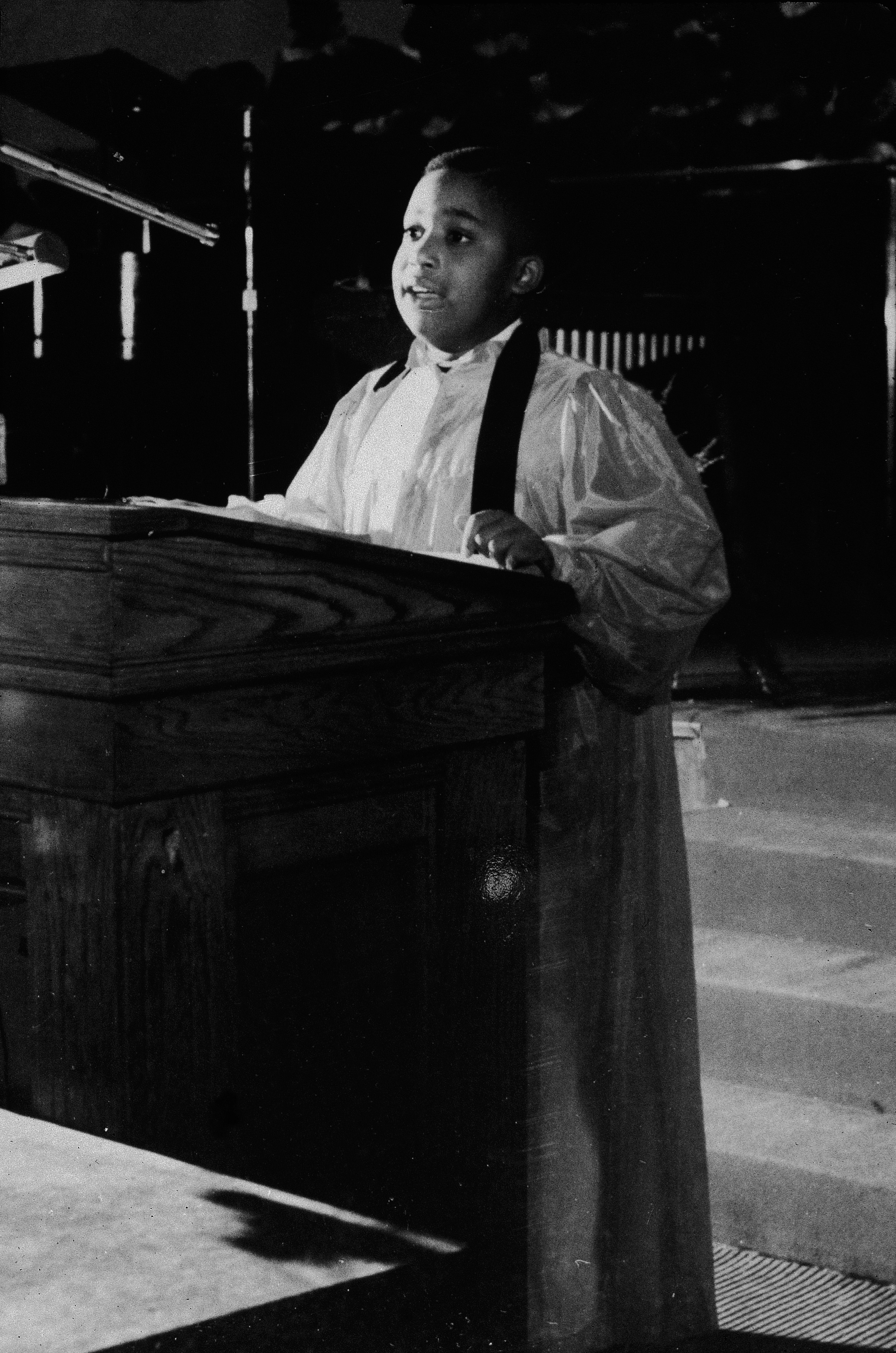 As a future American religious leader and civil rights activist, seven-year-old Al Sharpton preaches from a pulpit at Washington Temple in the Brooklyn borough of New York City, 1961.