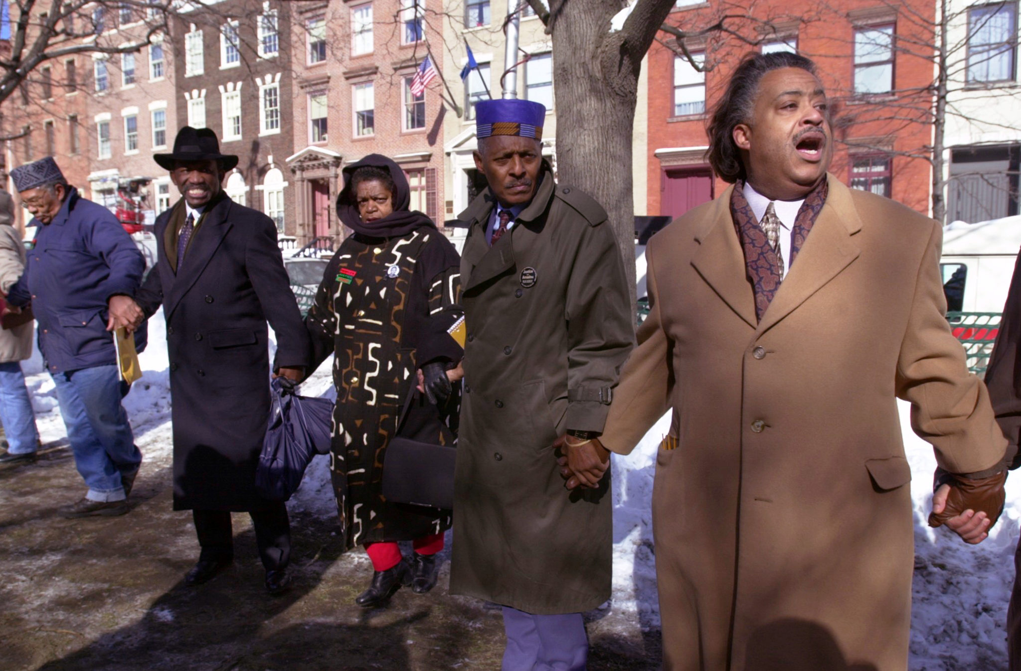Rev. Al Sharpton (right) and Rev. Herbert Daughtry (second from right) hold hands with fellow protesters during a prayer vigil outside of the Albany County Courthouse for Amadou Diallo, Feb. 2, 2000.