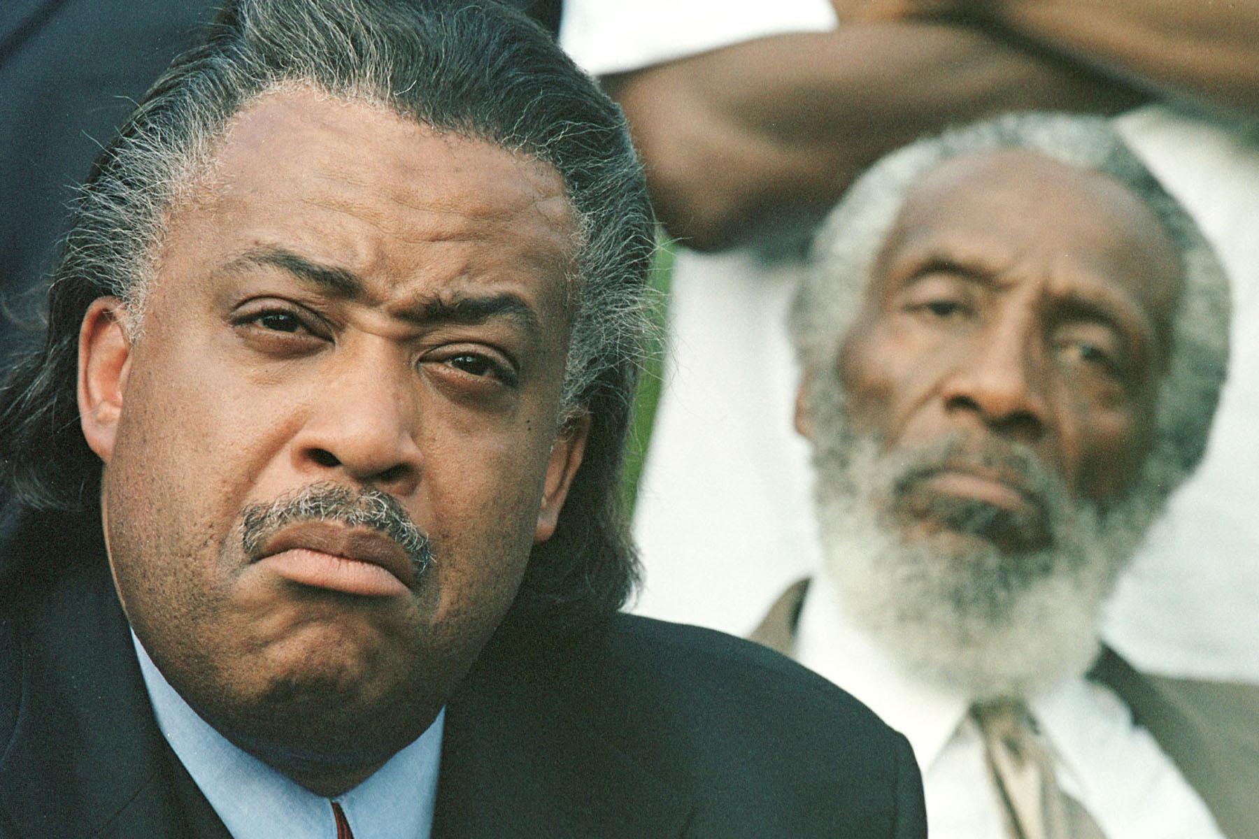The Reverend Al Sharpton, left, and activist Dick Gregory attend a rally in Dearborn, Mich. on July 5, 2000.